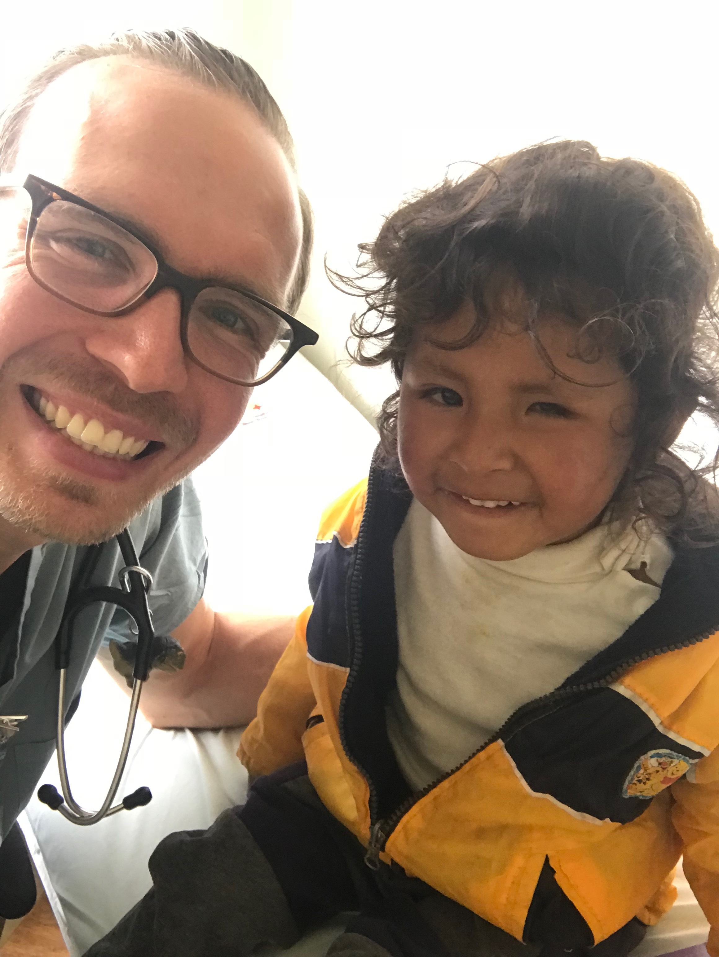 This little boy has a small left eye that is blind, most likely from birth. Many of the cases here are too advanced to fix. He will never be able to see from that left eye. But he's still a really happy kid and loved taking pictures.
