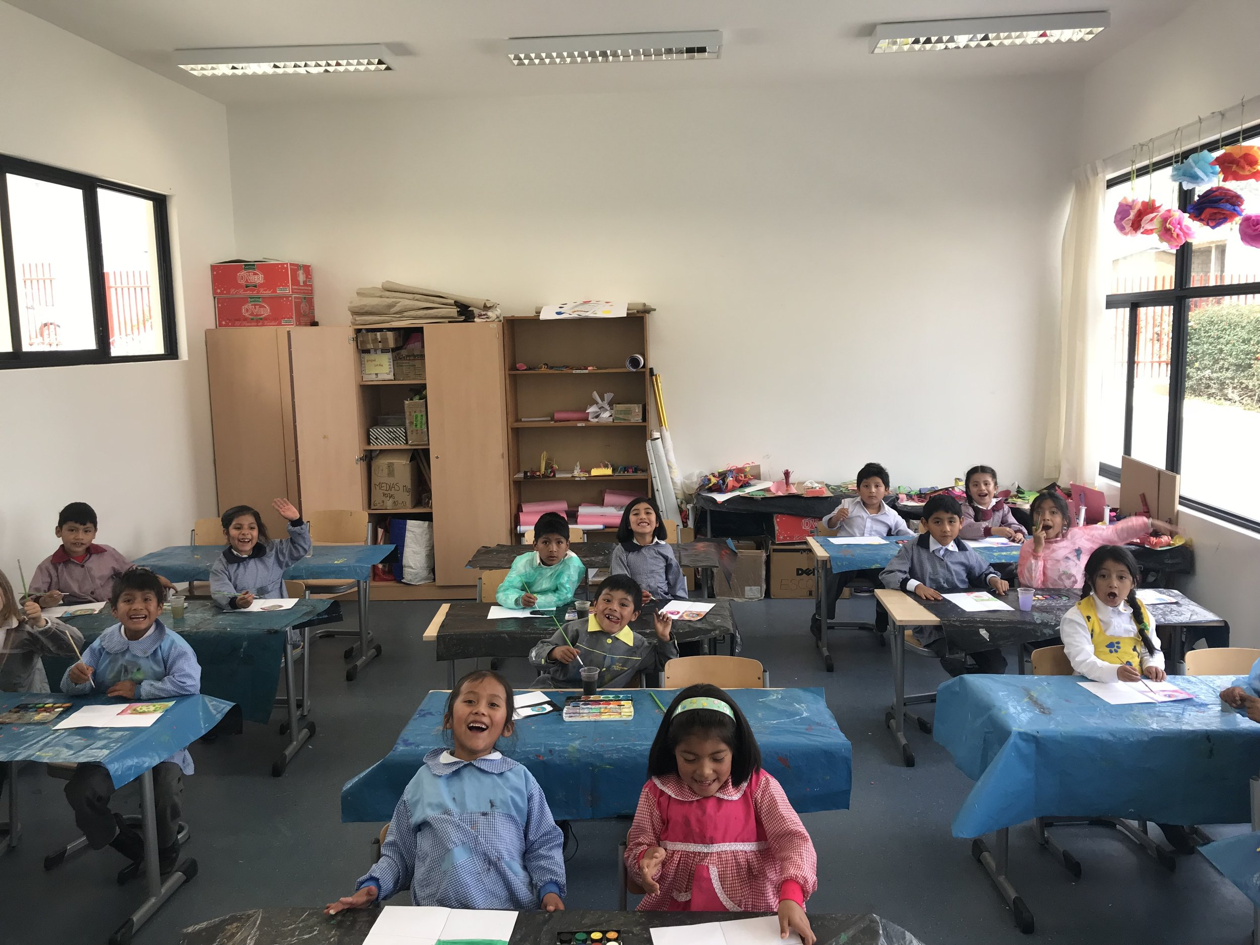 This is my first grade class (my favorite class), they love listening to Kids Bop Kids and dancing while they work (so cute). We were working on a mosaic with circles. They also did the pom poms on the windows.