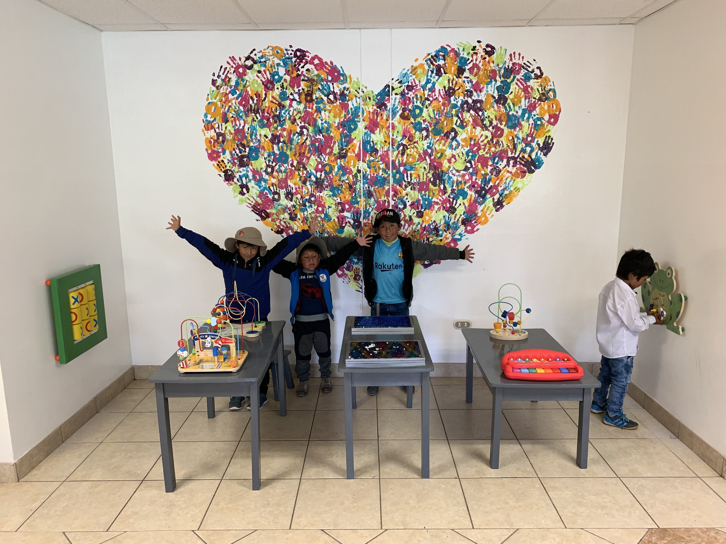 We screwed the toys to the walls and tables and asked some kids to test out the new area!