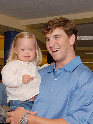 New York Giants and former Ole Miss quarterback Eli Manning holds Aubrey during a 2008 visit to Batson Children's Hospital.
