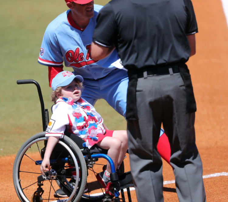 Carter throws the first pitch at an Ole Miss baseball game.