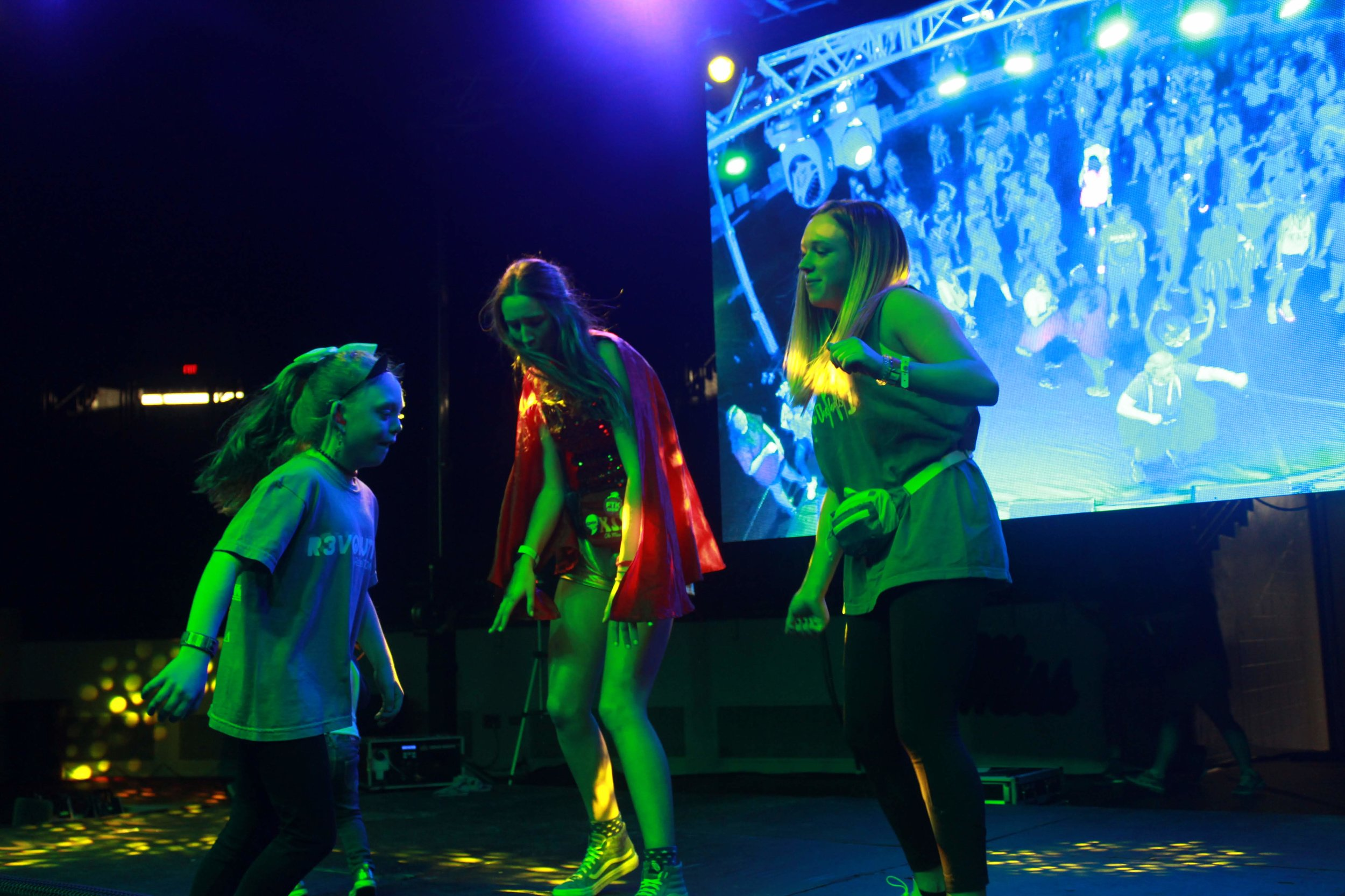 Emily and one our Miracle Kids, Avery Bell, dancing on stage at our 2019 Dance Marathon. Her passion for our cause inspires us all!