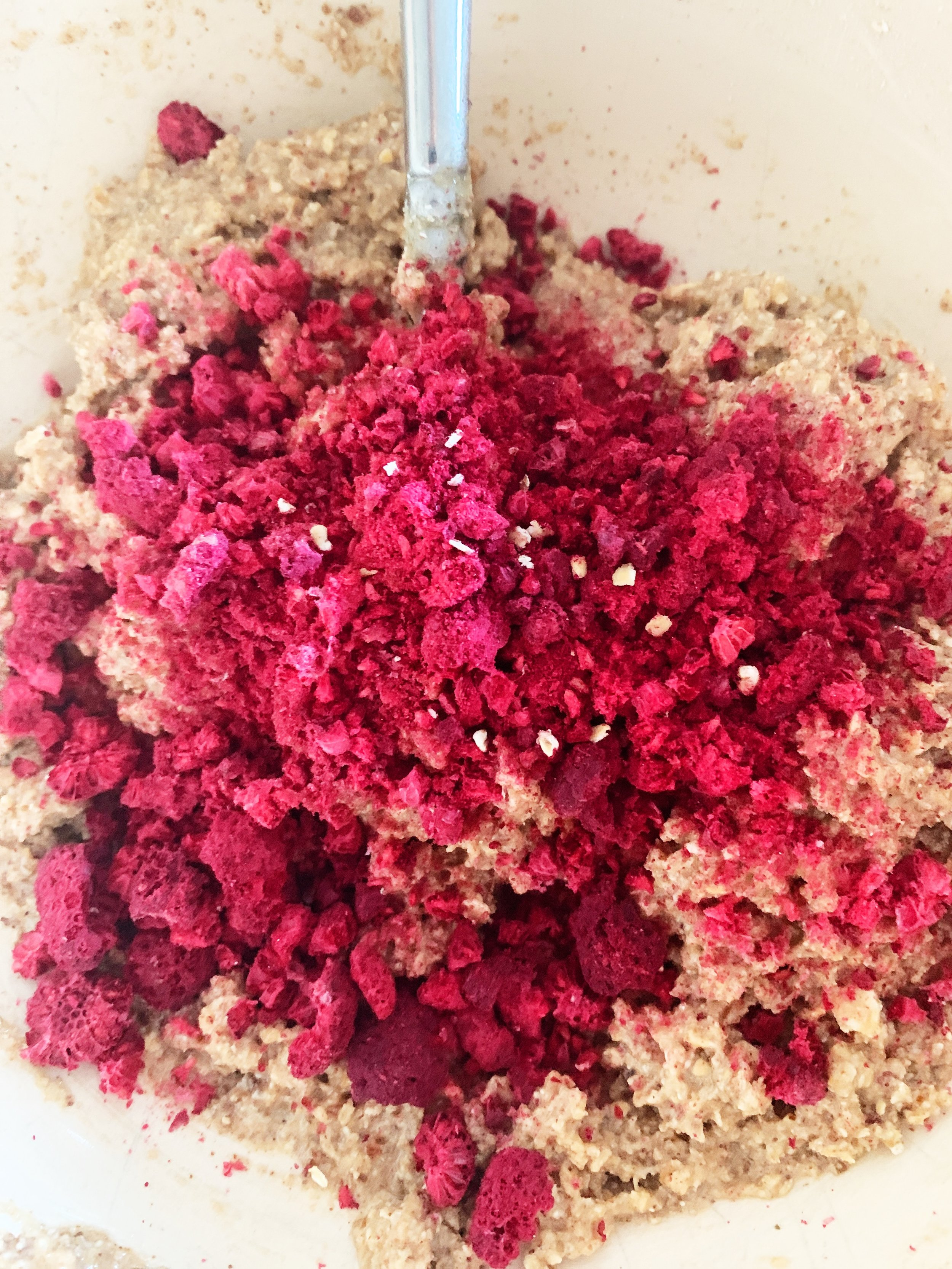 The natural color of the rasberries is stunning. This picture is of the mixture with the crushed rasberries layed on top. After which you combine together using a spoon or like me your hands.