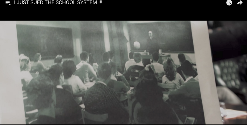 A picture of a classroom from 150 years ago, screen shot from  Prince Ea's YouTube video