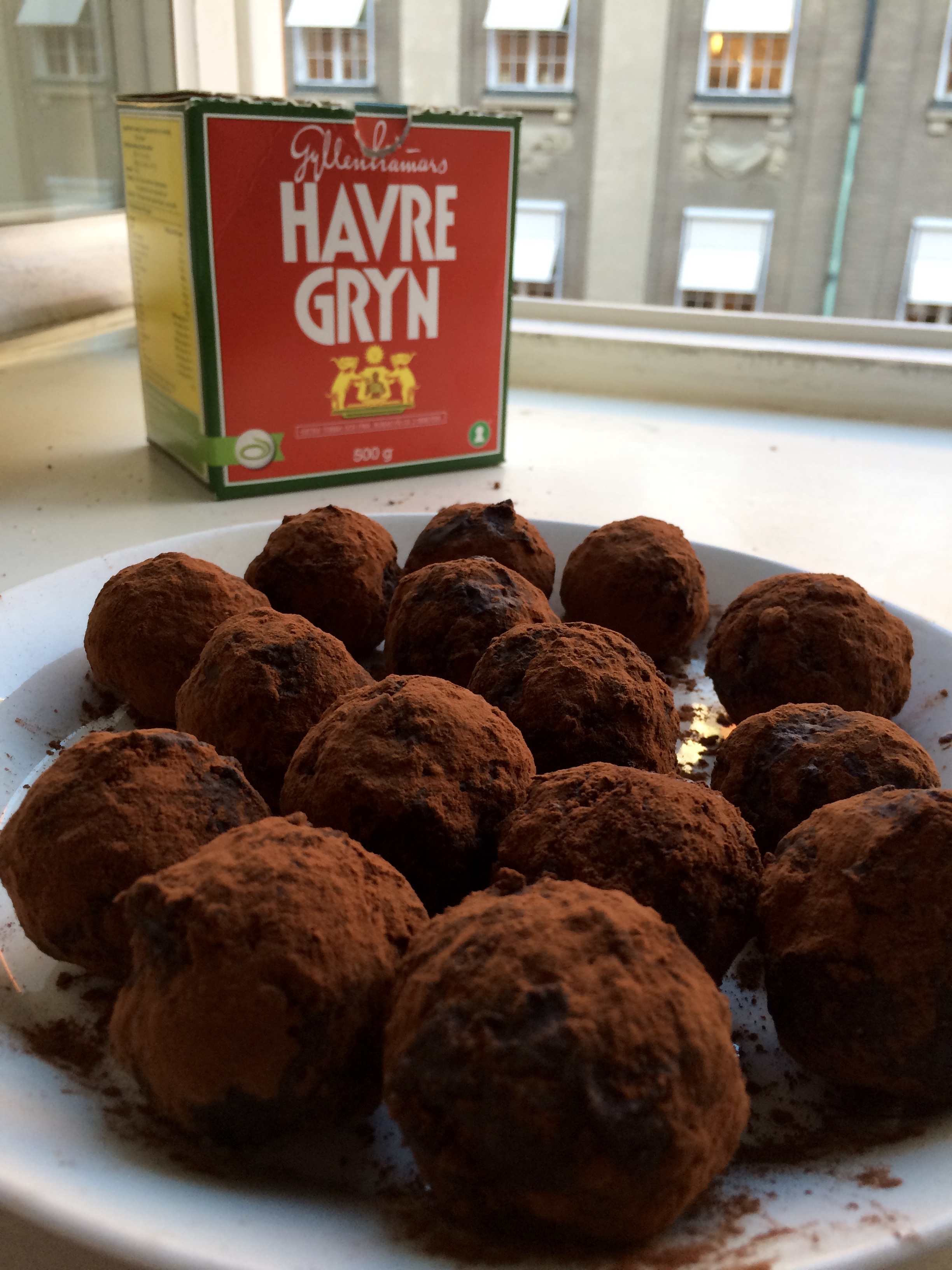 I like to also use Gyllenhamars  havre gryn  in Sweden. A picture of classic vegan chokladbollar rolled in cacao powder