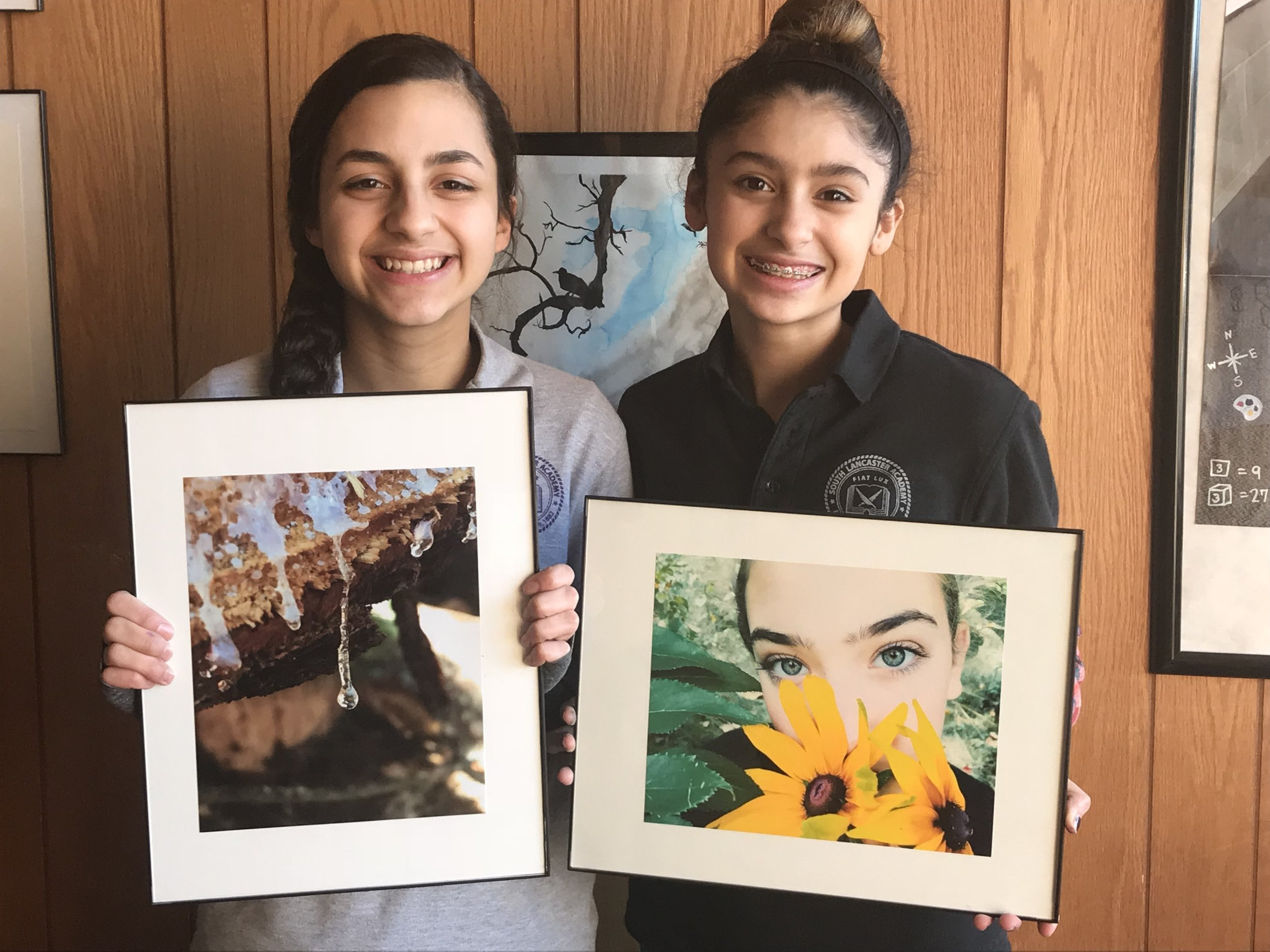 Stephanie De Abreu and Emma Ciccone with their photographs.