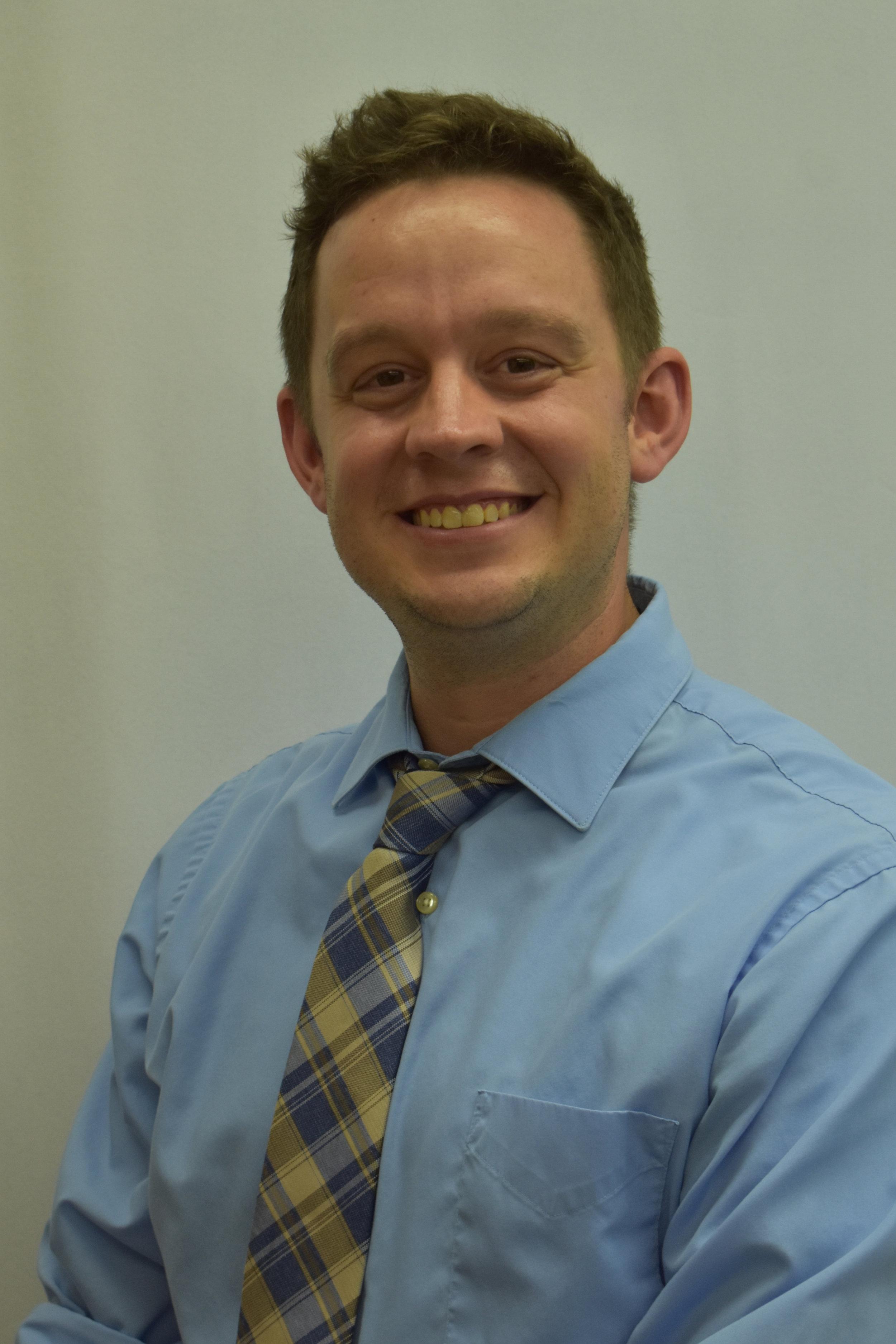 Mr. Aaron Fitzpatrick | Adviser