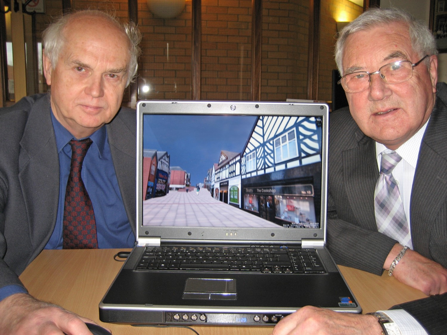 Northwich councilors in 2006 with their 3D laptop enabling them to walk around the virtual reality model of Norwich which was being used as part of their planning review process.