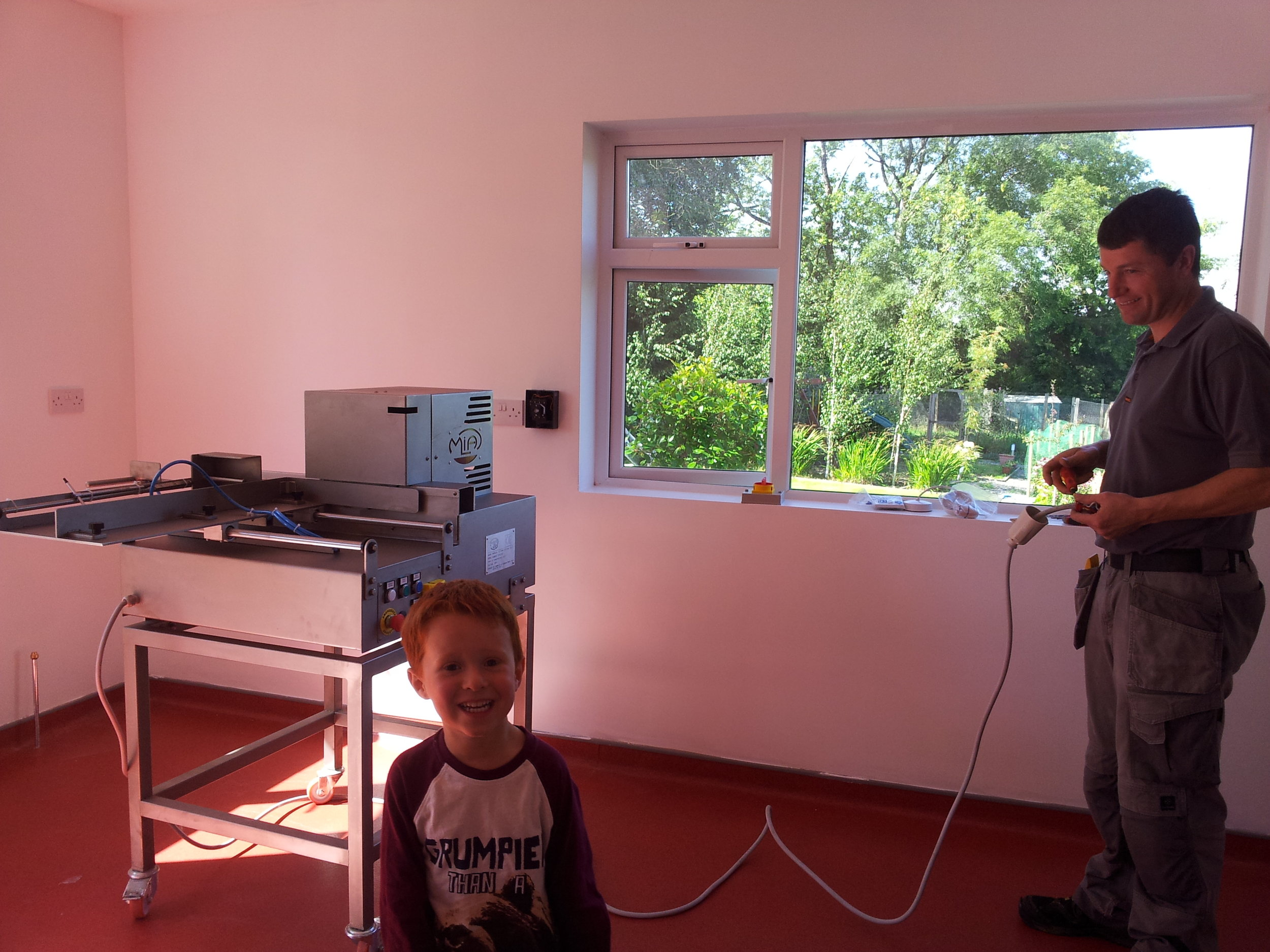 By the end of the summer the kitchen is starting to look better and here my darling Ethan is helping our electrician.