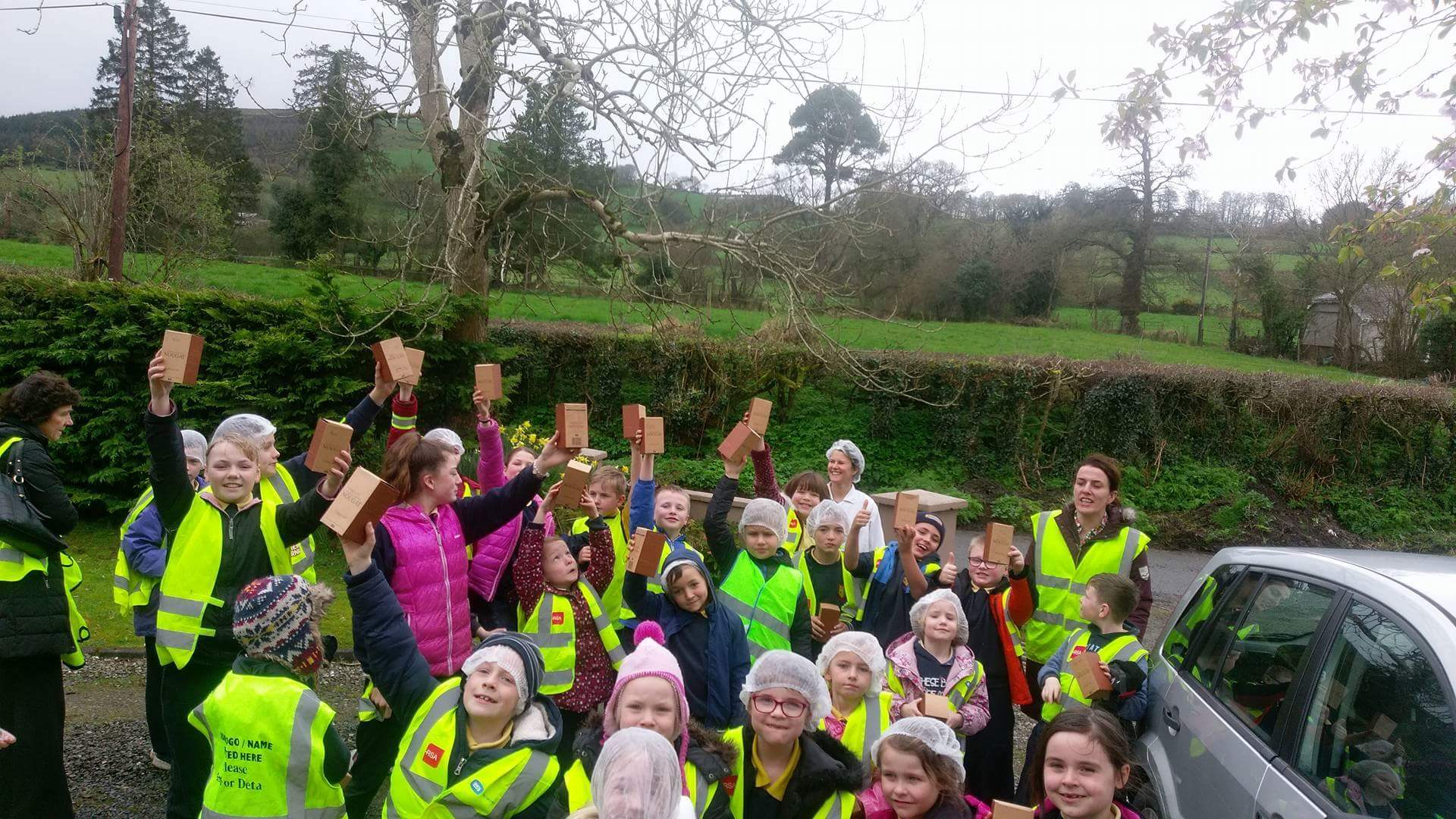 We had a very exciting visit from the children of Donoughmore NS.They all walked from the school and we gave them the ins and outs of our nougat kitchen. They even got to hand wrap nougat sweets and took them home. Some even kept their hair nets on for the day.