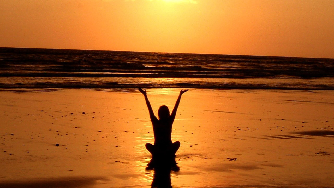 Beach at sunset - healing yoga for sexual assault survivors