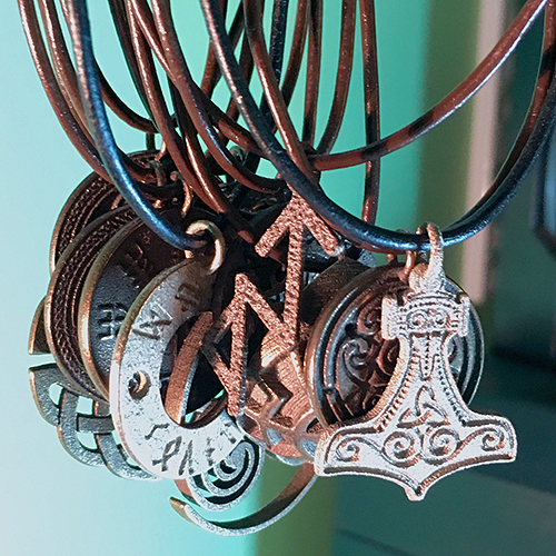 A line of jewelry for him or her, made of stainless steel and bronze and gold finishes, featuring traditional symbols from ancient cultures.