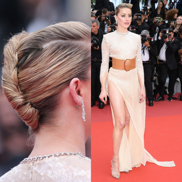 Amber Heard in een jurk van Claes Iversen. Haar haren zijn gestyled in een edgy zijwaartse knot. Aanbevolen product:  Give Me Hold Strong Spray . Bron: Pinterest