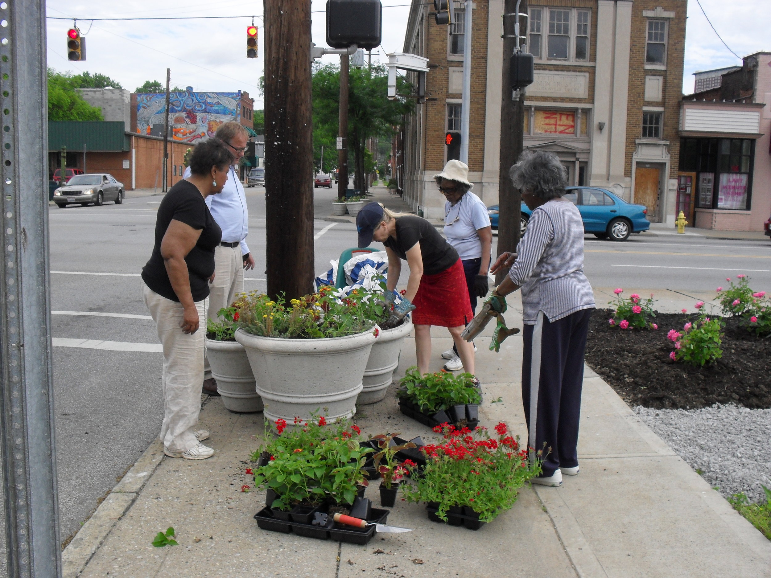 MCC Beautification Committee planting street planters 5-22-2013.JPG