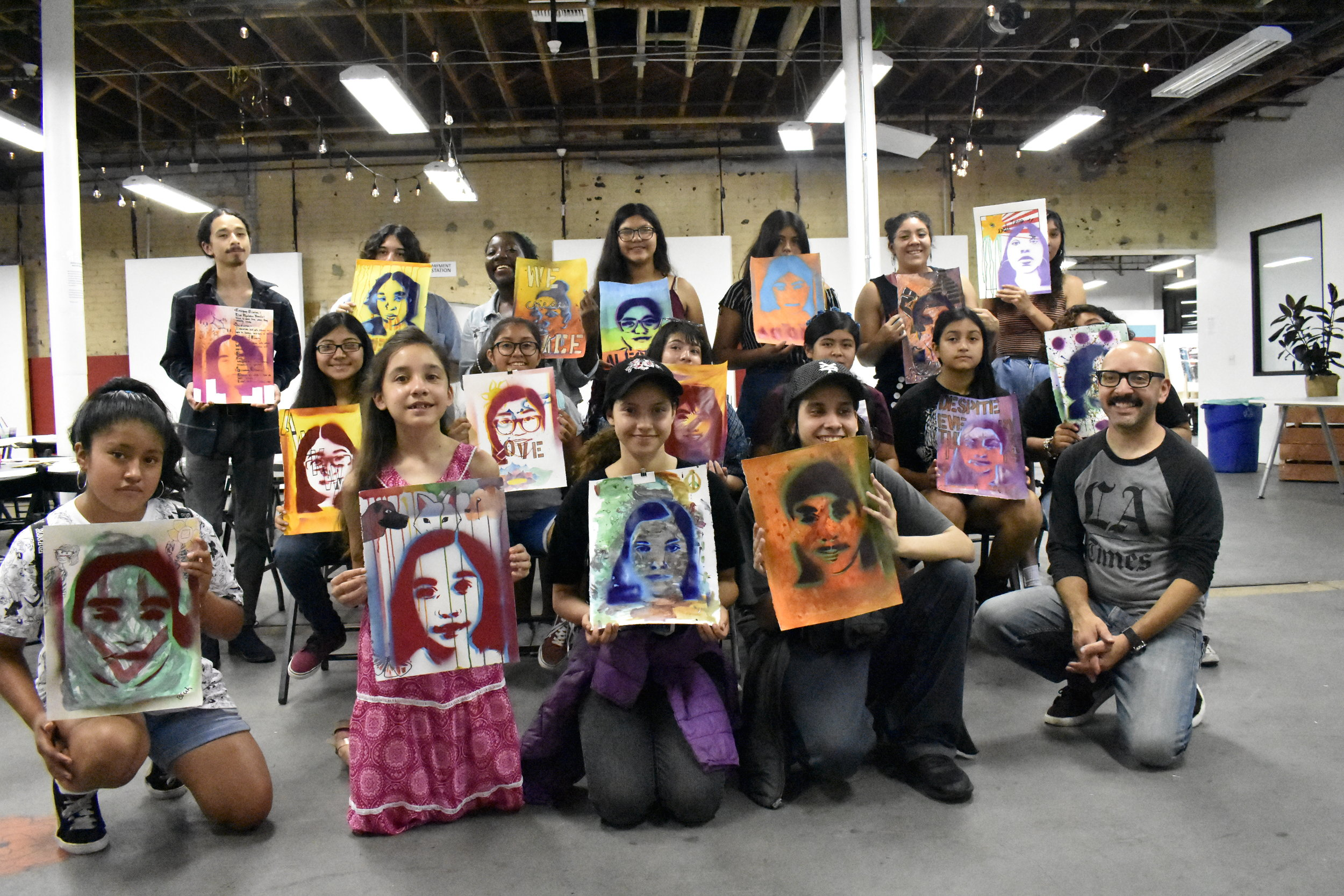 Luis Genaro-Garcia and his class during the first week of S.O.Y Artista proudly showcasing their self-portraits.
