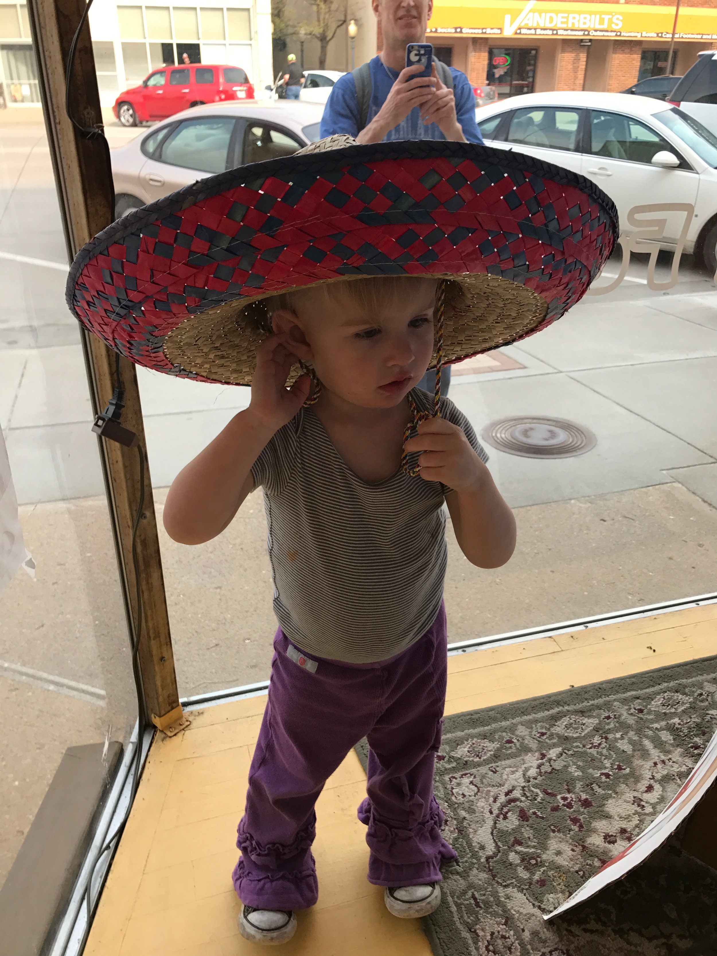 As I said, she loves to climb. And try on hats in windows.