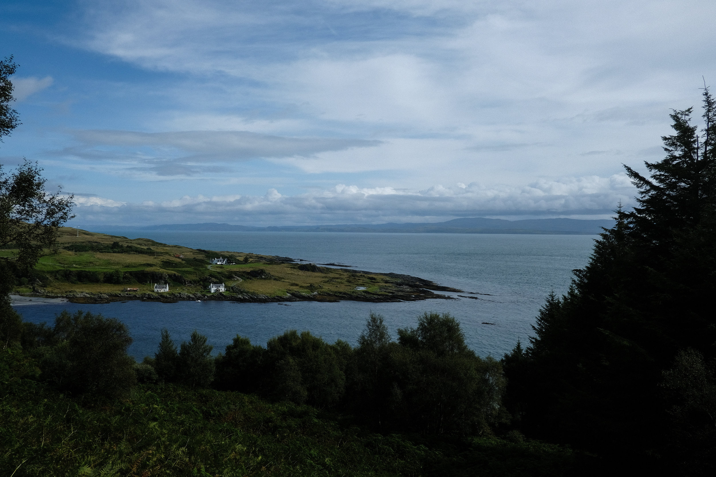 As you travel north on Jura, the road wraps around the coastline, climbing in elevation over small coastal settlements like this one—the village of Tarbert.© Adam McCauley | 2017