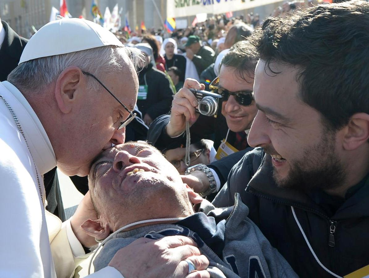 Pope Francis kissing disabled man - cropped