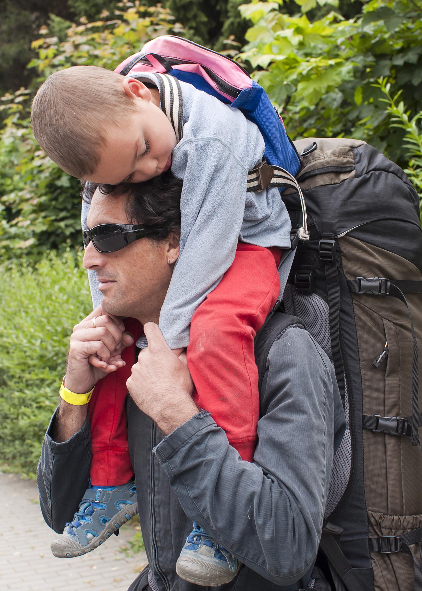Dad-carrying-sleeping-son-on-shoulders.jpg