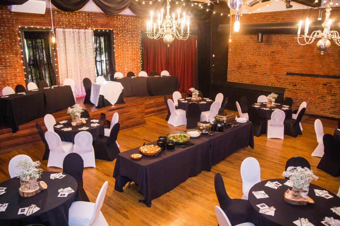 Seating for 48 guests on the floor + 12 on the stage. Room on the balcony for up to 34 more.