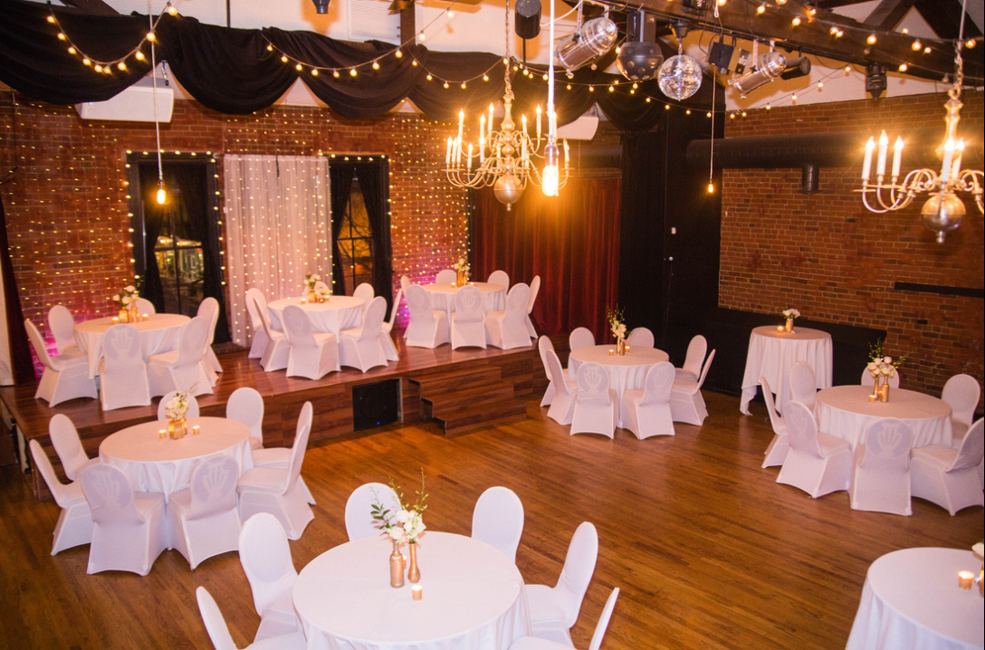 Seating for 32 guests on the floor + 21 on the stage. Room on the balcony for up to 34 more.