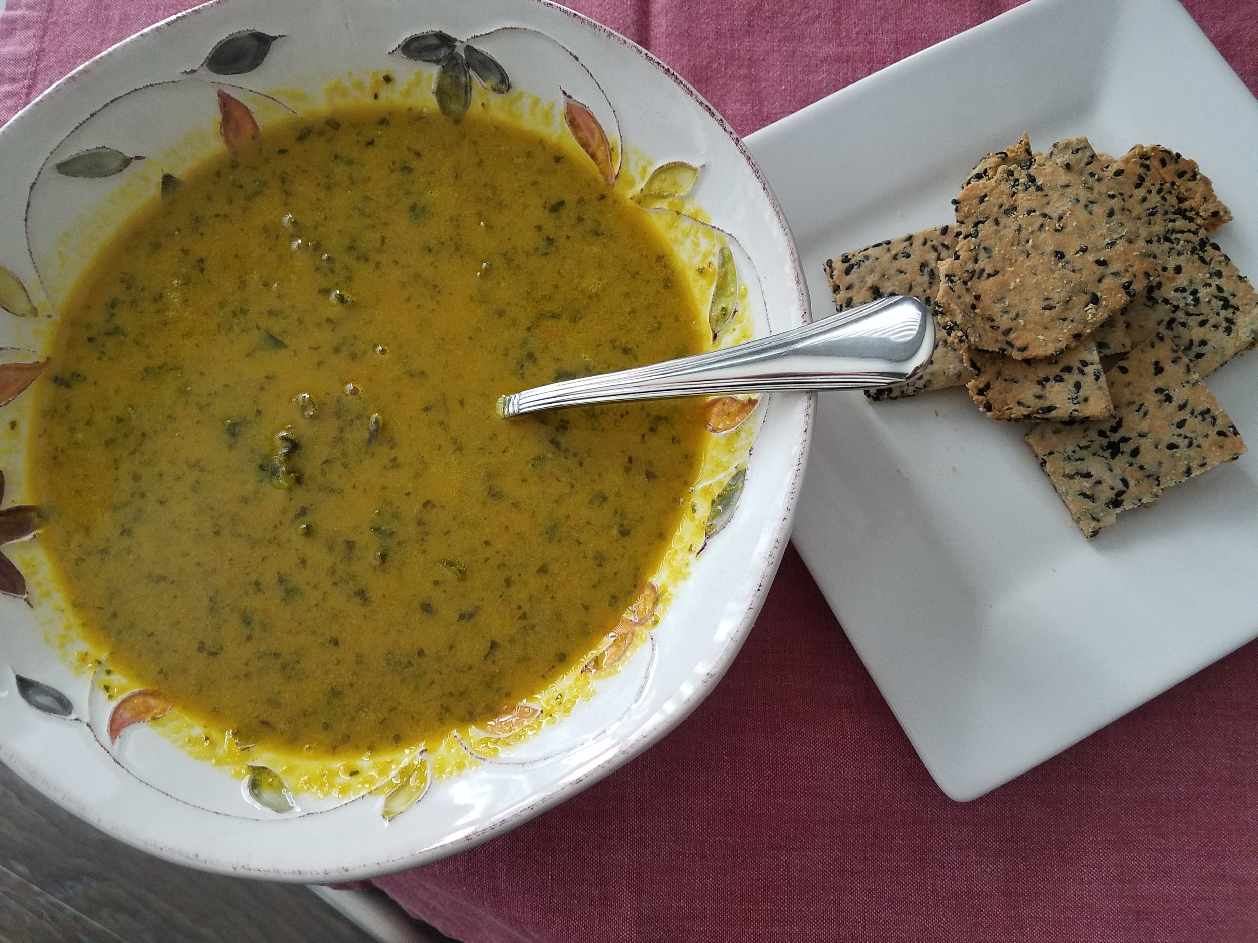 Creamy Carrot & Kale Soup with protein rich sesame crackers by Tam John
