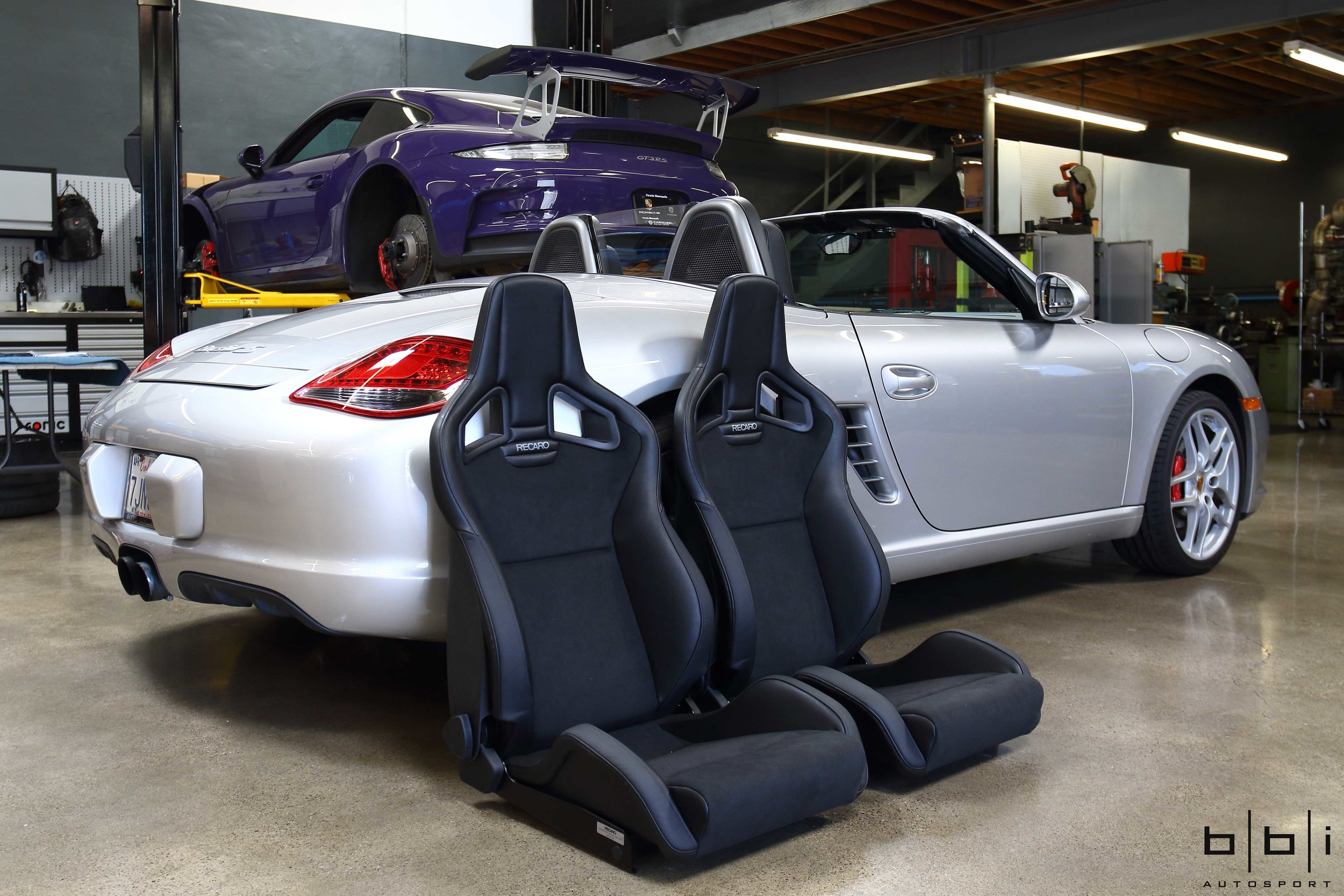 Factory seats often leave much to be desired and this client with a Porsche 987 Boxster felt that the factory seats lack support so we replaced it with the popular RECARO reclining seats for improved ergonomics and support. Mounted on our BBi Autosport Seat Base and Slider Kit, the Sportster CS seats provides a sleek, distinct, eye-catching look. The integrated headrest and aggressive bolstering are reminiscent of racing seats while the comfort and ergonomic qualities are evocative of the world's top sport luxury automobiles.
