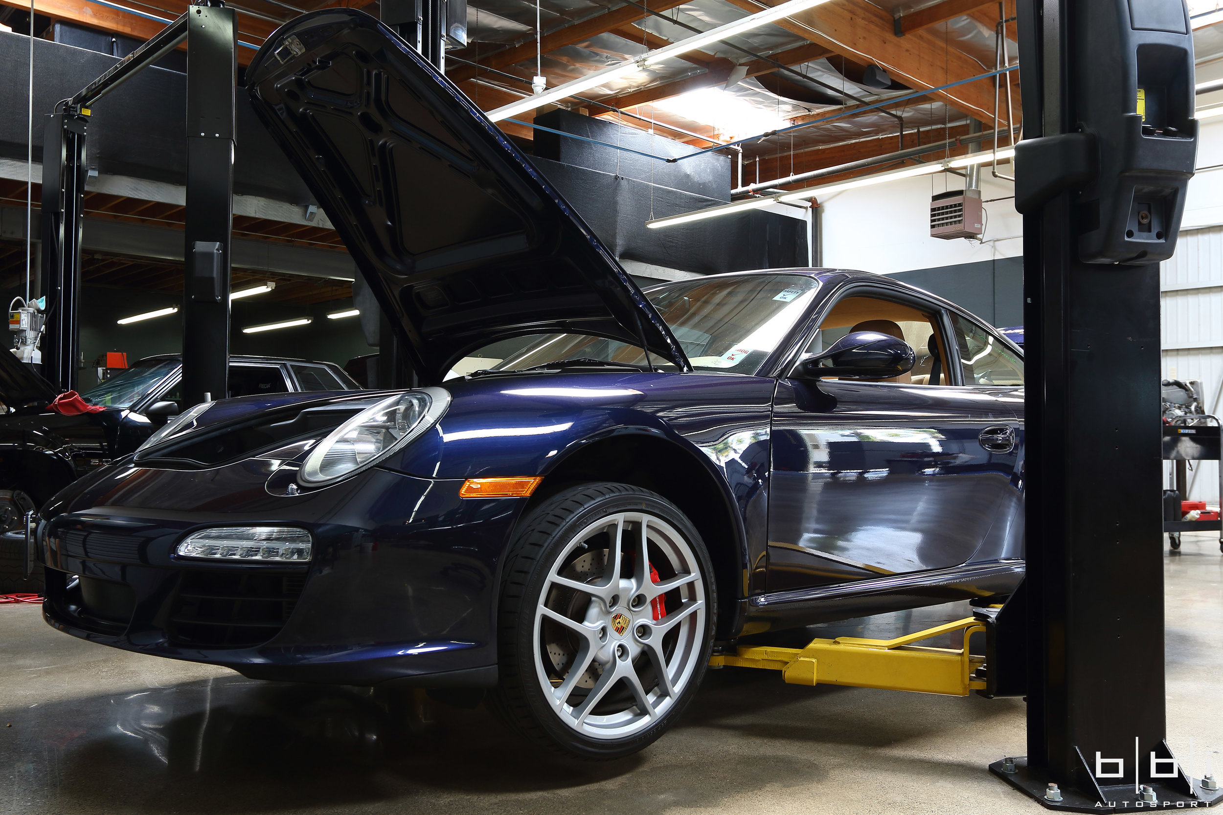 With a life long dream of owning a Porsche, our client was torn between the 997 Carrera and 987 Cayman for his first Porsche. We offered to lend our expertise and help make an informed purchasing decision on whichever platform he decides to go with. After a long search for the right car at the right price, he had his eyes set on this clean low mileage Porsche 997.2 Carrera S PDK and brought it to our service department so that we can perform a PPI (pre-purchase inspection) to uncover any possible hidden flaws or issues. We don't think you can go wrong with a 997.2 Carrera S PDK as a first Porsche and everything appears to be good. Here are some pictures of the car getting an inspection in our service department.