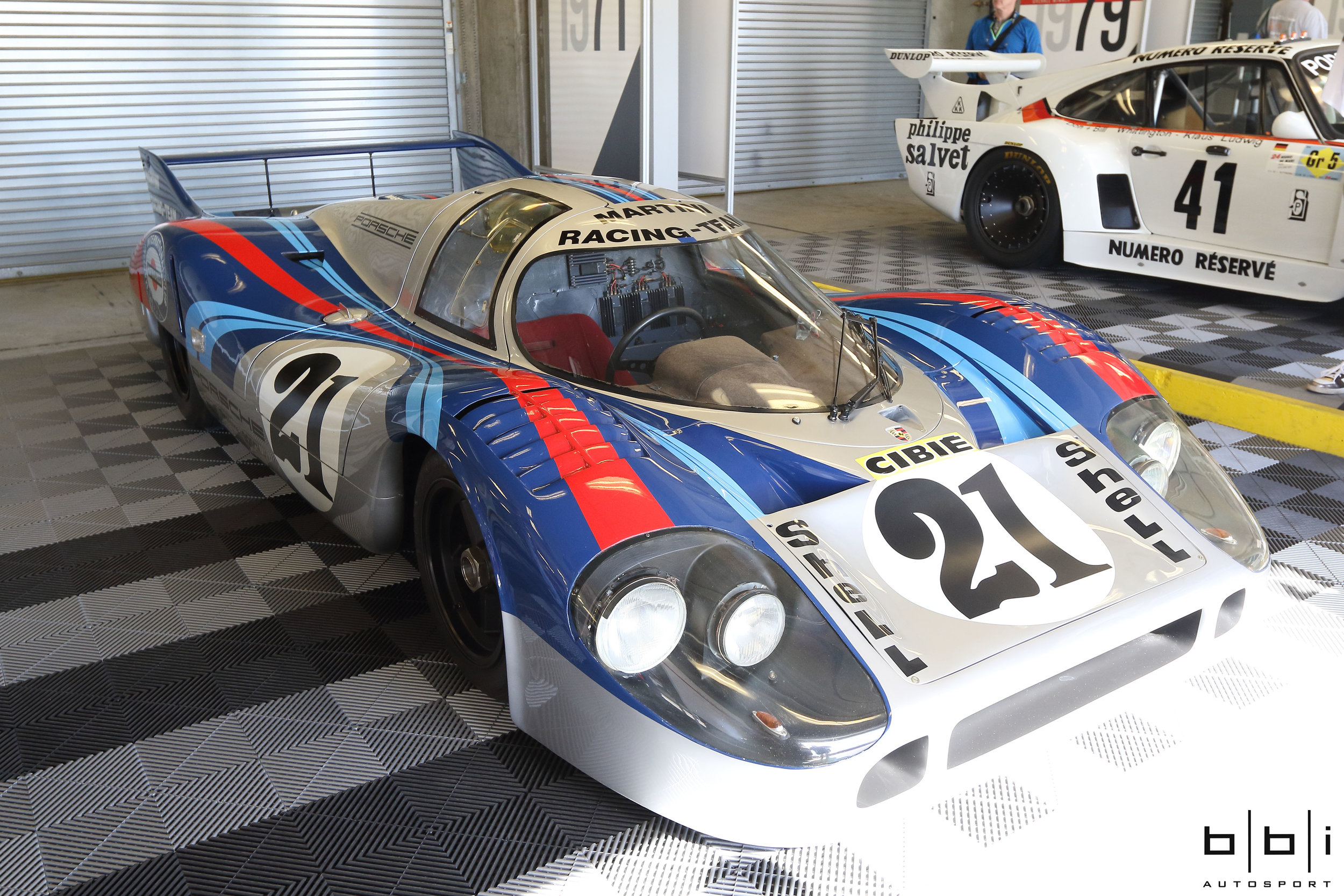 #21 1971 Porsche 917 Longtail Martini.Porsche engineers developed different car body models to meet the different demands of different racetracks. The so-called short-tail model was designed for heavily twisting roads in which a high contact pressure was necessary for fast cornering. The long-tail model was designed for fast racetracks and a high final velocity. These cars were reaching impressive speeds on the Mulsanne. In 1971, during night practice, a 917LH (Langheck - long tail), driven by young Mexican driver Pedro Rodriguez (1968 Le Mans winner), clocked at a top speed of 398 km/h, or about 249 mph.