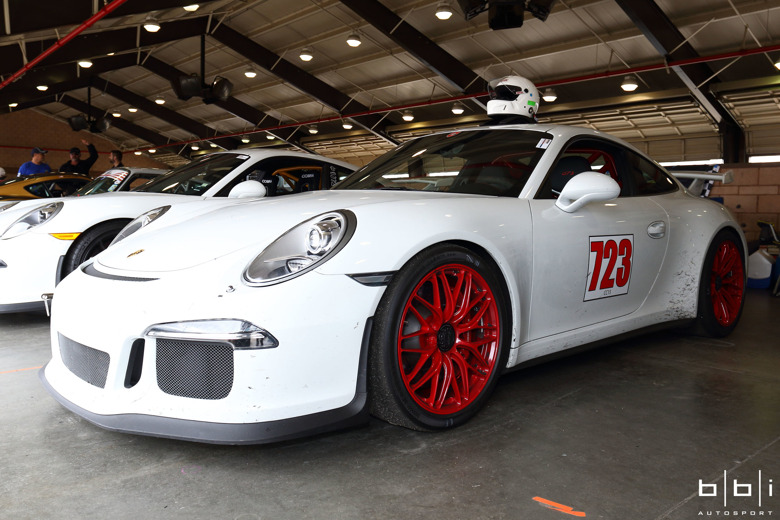 Porsche 991 GT3 with Gloss Red BBi Roll Bar. Covered with rubber tire marks, we're always stoked to see our customer cars get properly used on the track as it was designed for.