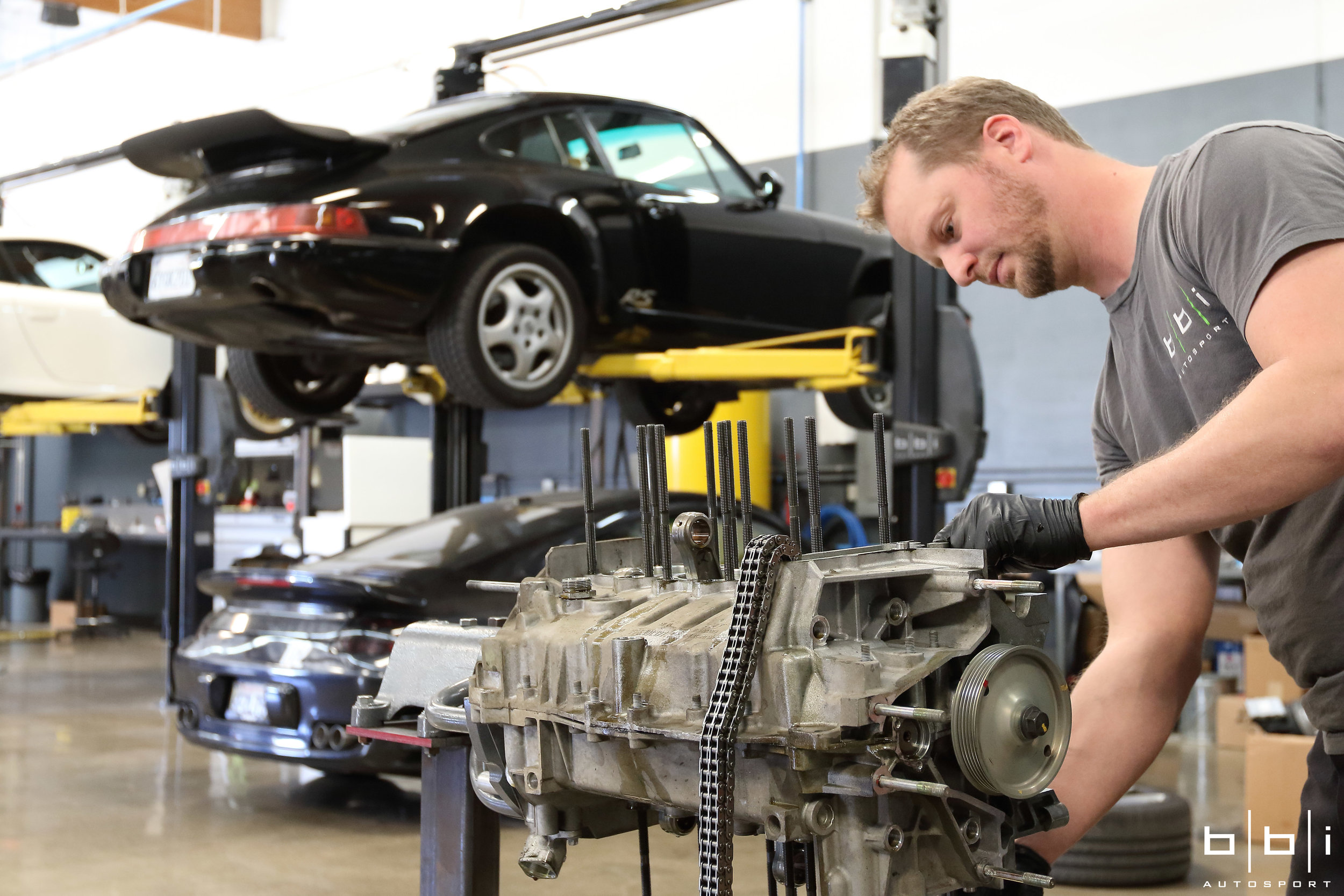 Disassembling the engine to clean and inspect components.
