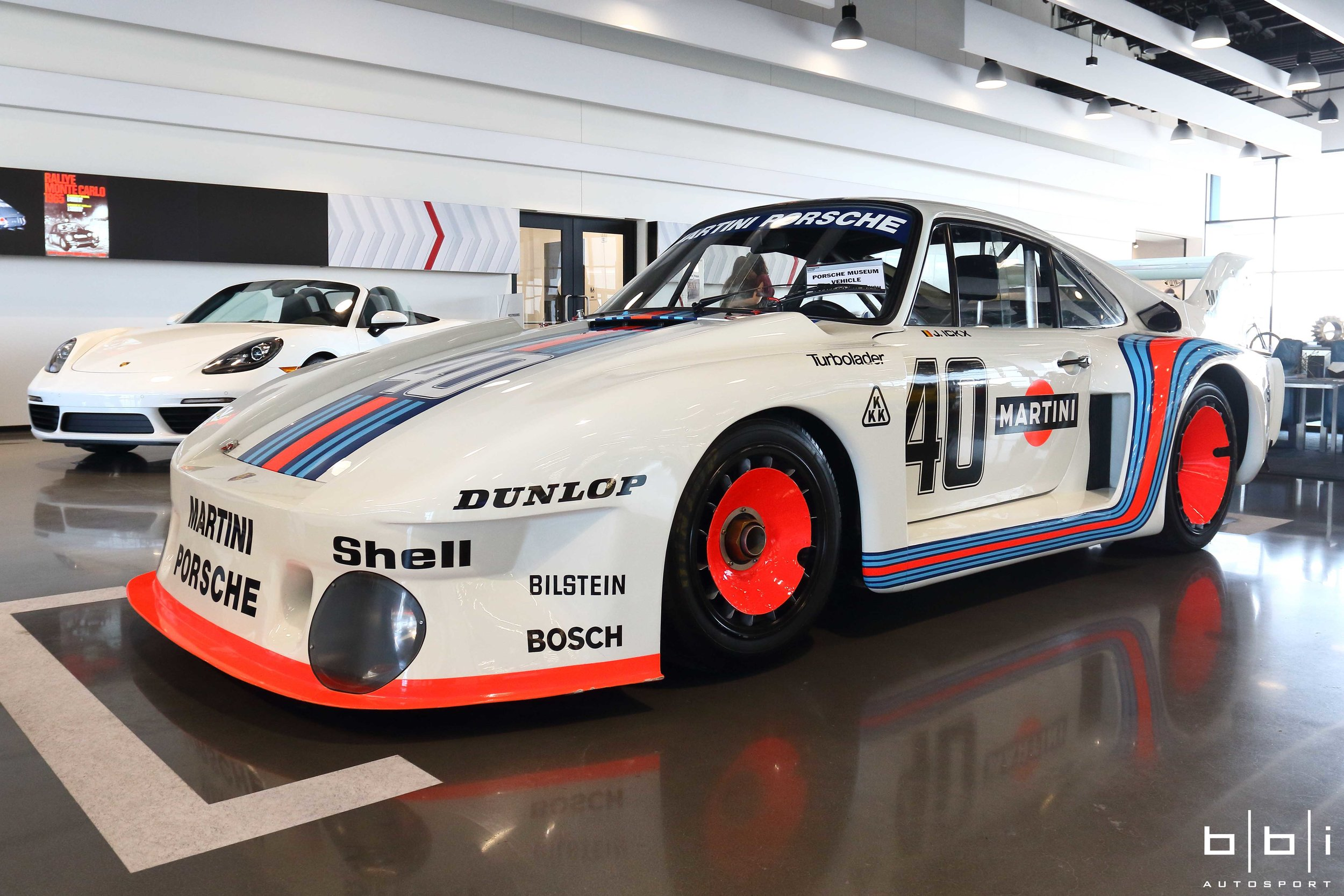 """Inside, our favorite car on display was this 1977 Porsche """"Baby"""" 935/2.0. To comply with 2 liter regulations of the class, the """"Baby"""" 935 with the legendary Martini livery has a tiny single turbo 1425 cc engine producing 370hp."""