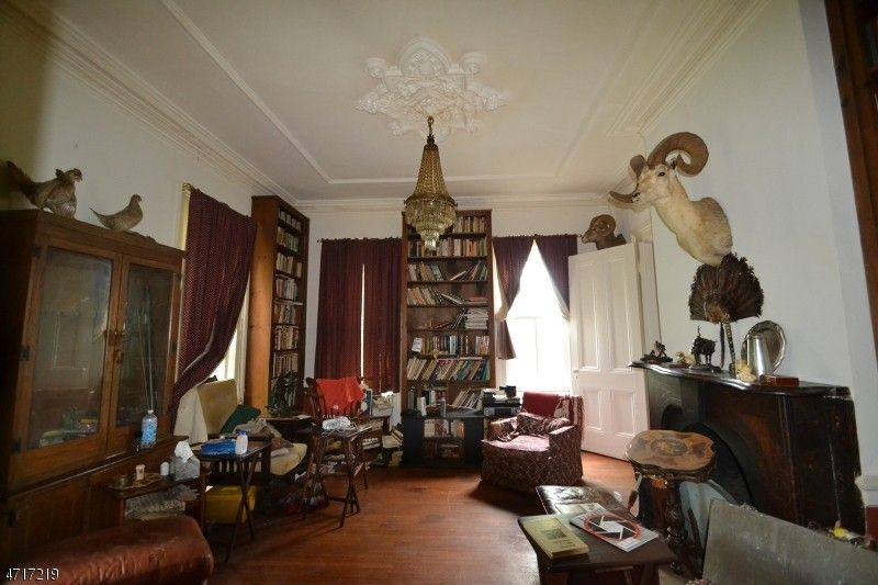 The parlor where the prior owner kept all of his guns. And yes, all of those heads are his trophies.