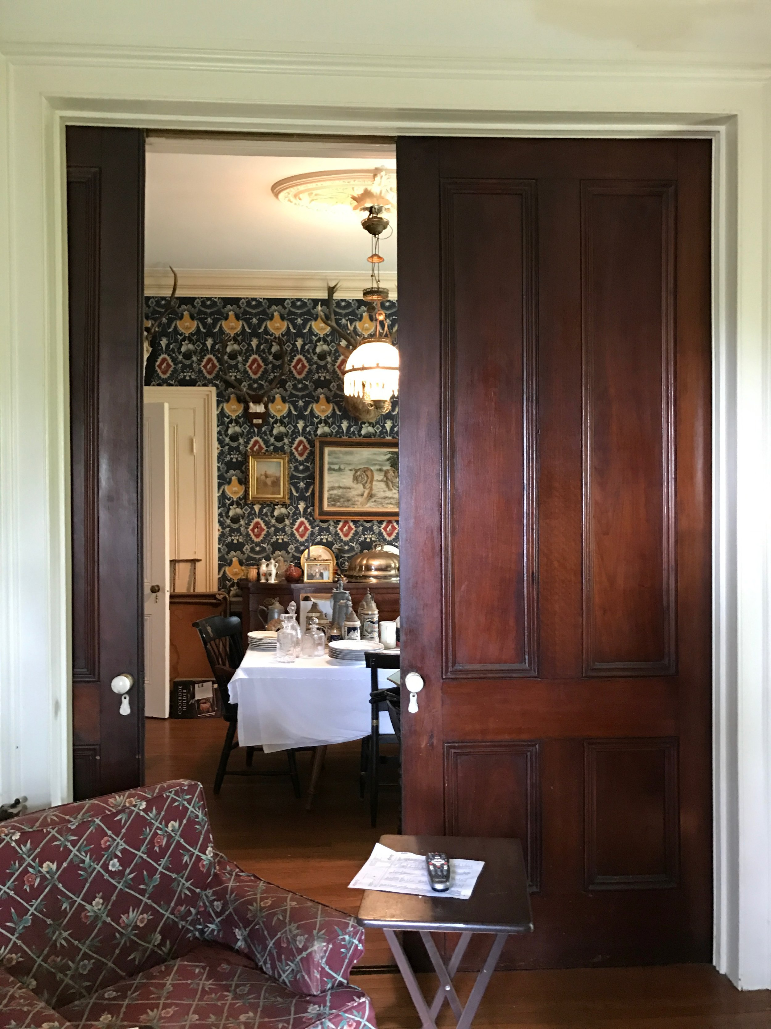 The cool pocket doors leading from the parlor to the dining room. Look at that wallpaper!