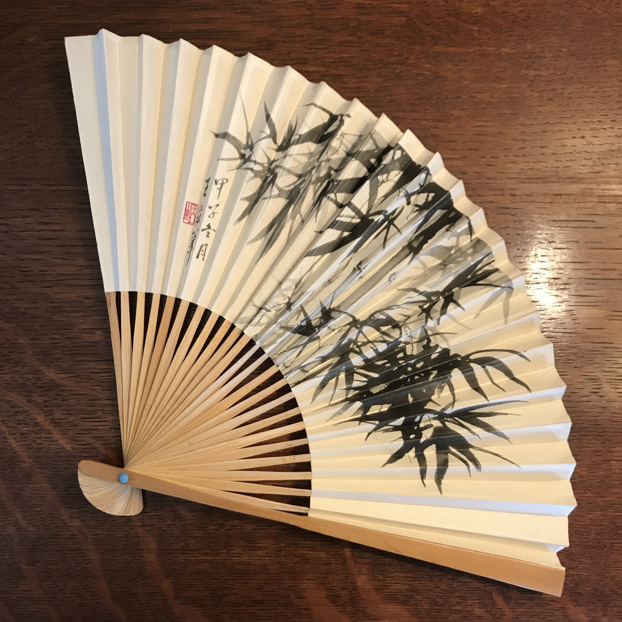 Vintage Chinese Paper Fan - Chinese Aviation Administration of China fans from the late 40s to the late 80s. The paper and bamboo show some age spots upon closer inspection. A little over 9