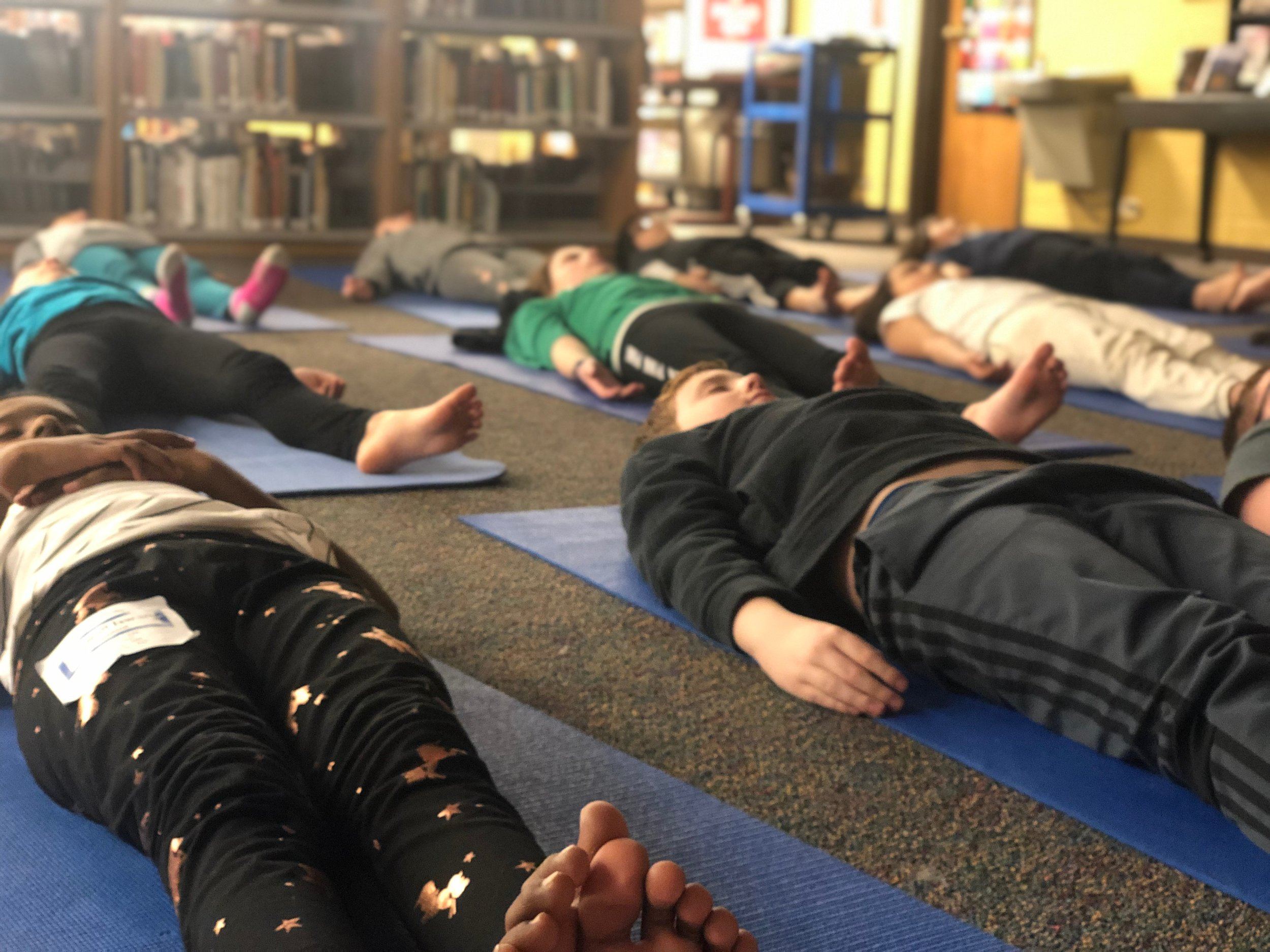 Students practicing yoga. One of 6 fitness and wellness activities offered as part of an interdisciplinary unit.