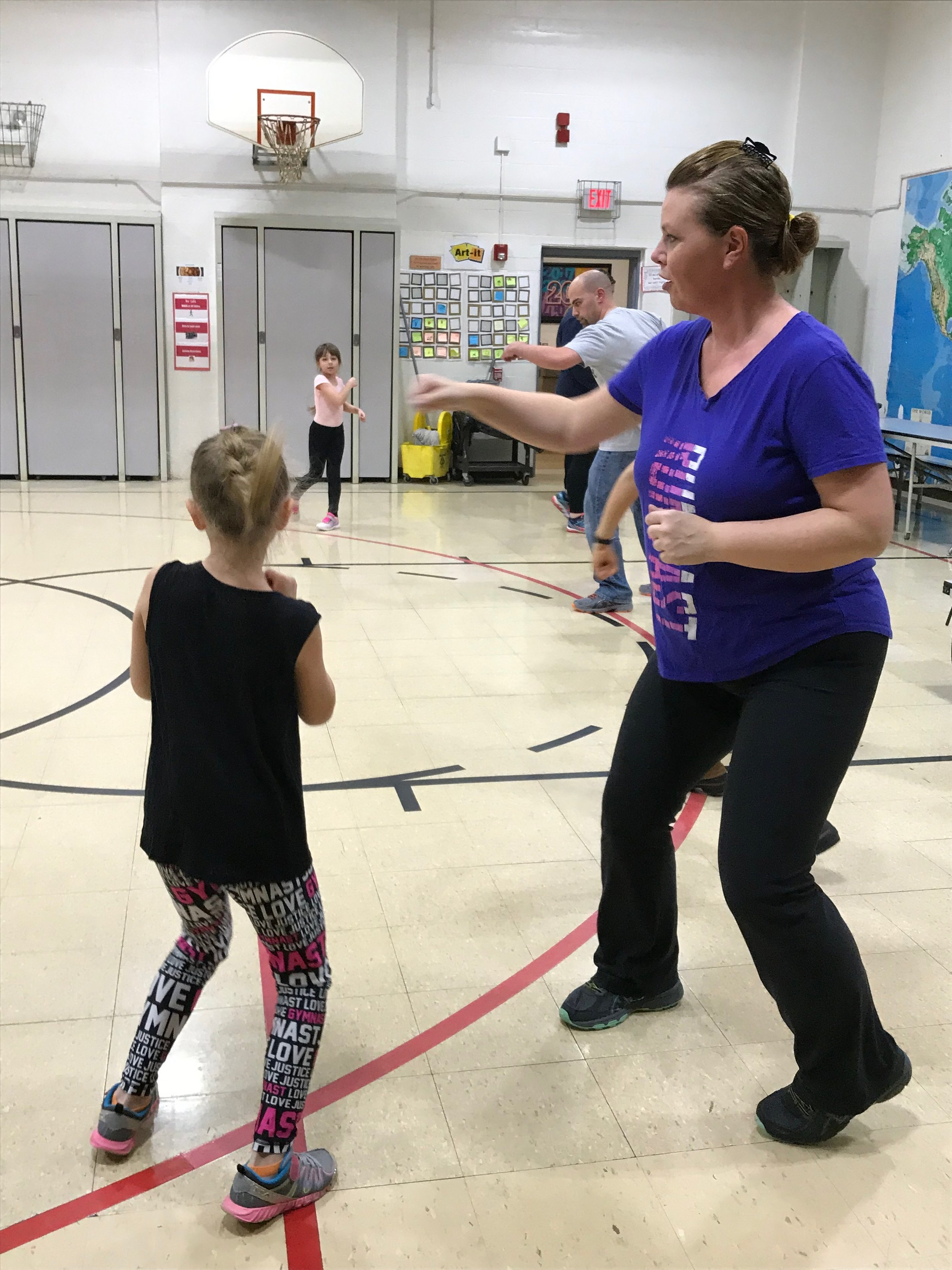 Families rotated through 3 fitness classes. Families kickboxing together.