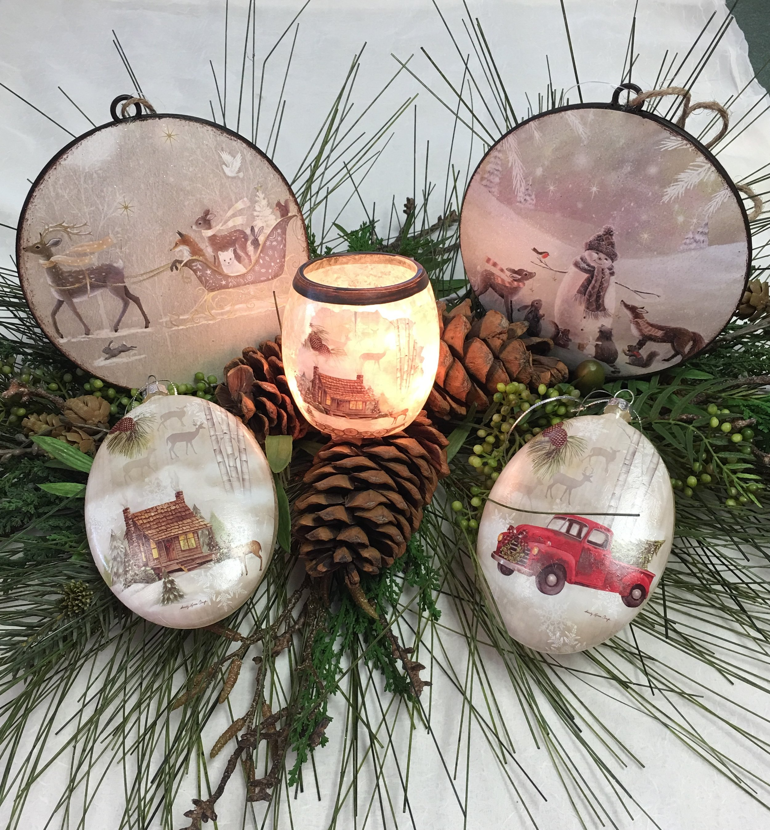 Ornaments by Accents Flags, Gifts, Home & Garden - Featured are beautiful rustic forest friends round ornaments and the popular Red Truck and Winter Cabin Glass Oblong Ornaments.Price: $9.50