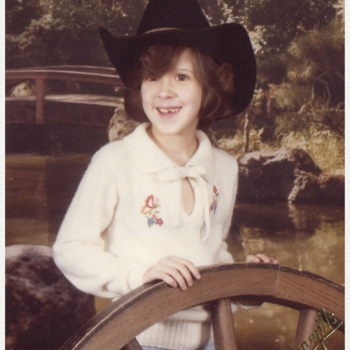 when you grow up in lubbock tX in the 1970/80s you are required to get a cowgirl picture made at the local olan mills studio. The best thing about this pic is my husband has the exact same pic of him at this age. we both grew up in lubbock but didn't meet until high school