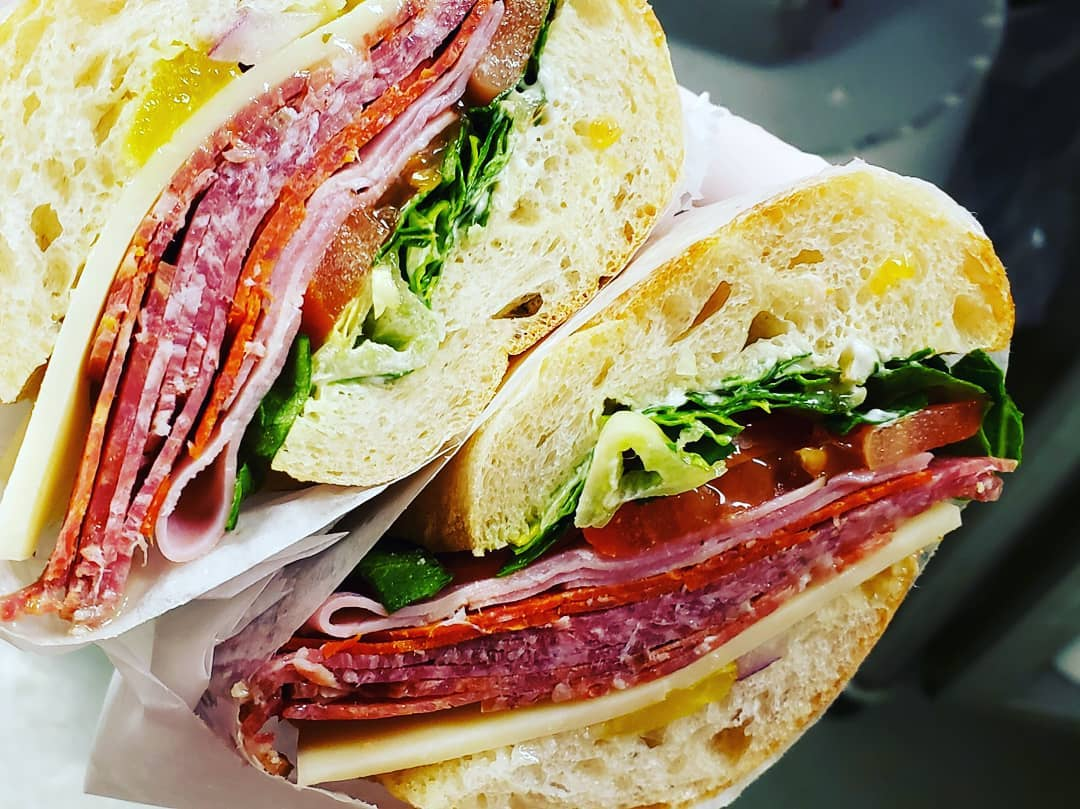 THE GUIDO - Ham, Genoa Salami, Pepperoni, Sopressa, Lettuce, Tomato, Onion, Smoked Provolone, Banana Peppers, mayo & our house made Sweet Italian Vinaigrette on Ciabatta Hoagie. It's quite the classic Italian sandwich!