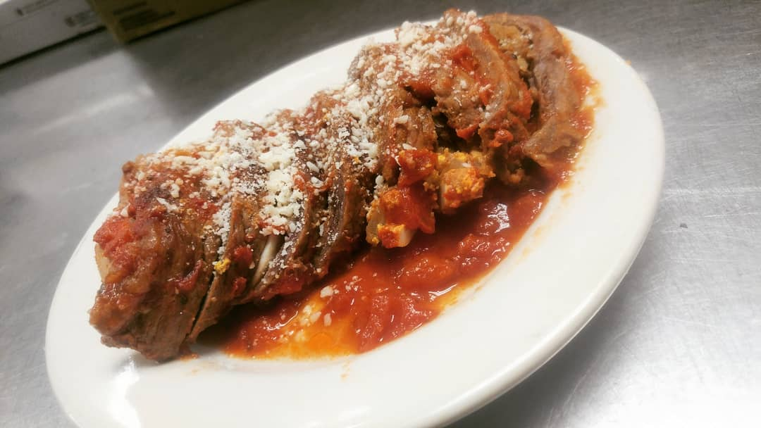 Braciole - Thinly sliced beef rolled with prosciutto & a hard boiled egg, braised slowly in our family marinara