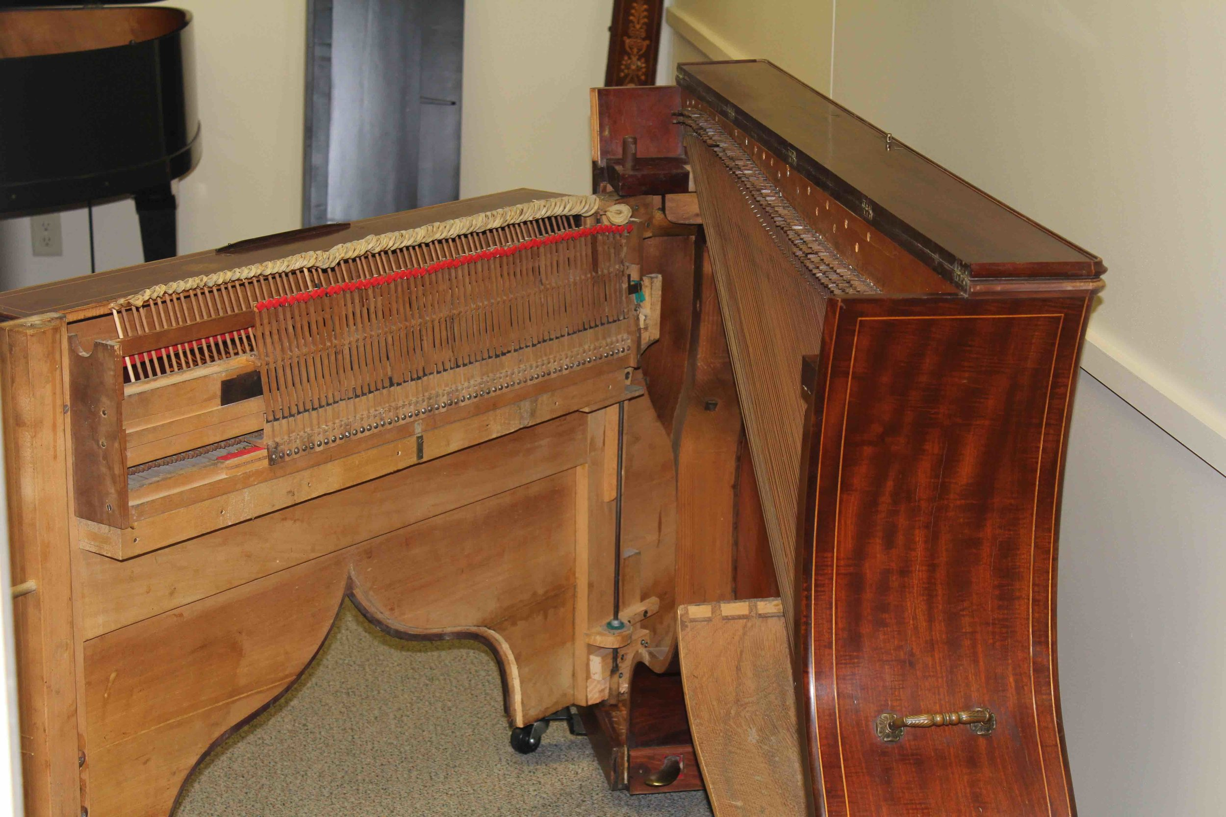 While most of the piano is original, the damper felts (red) have been replaced.