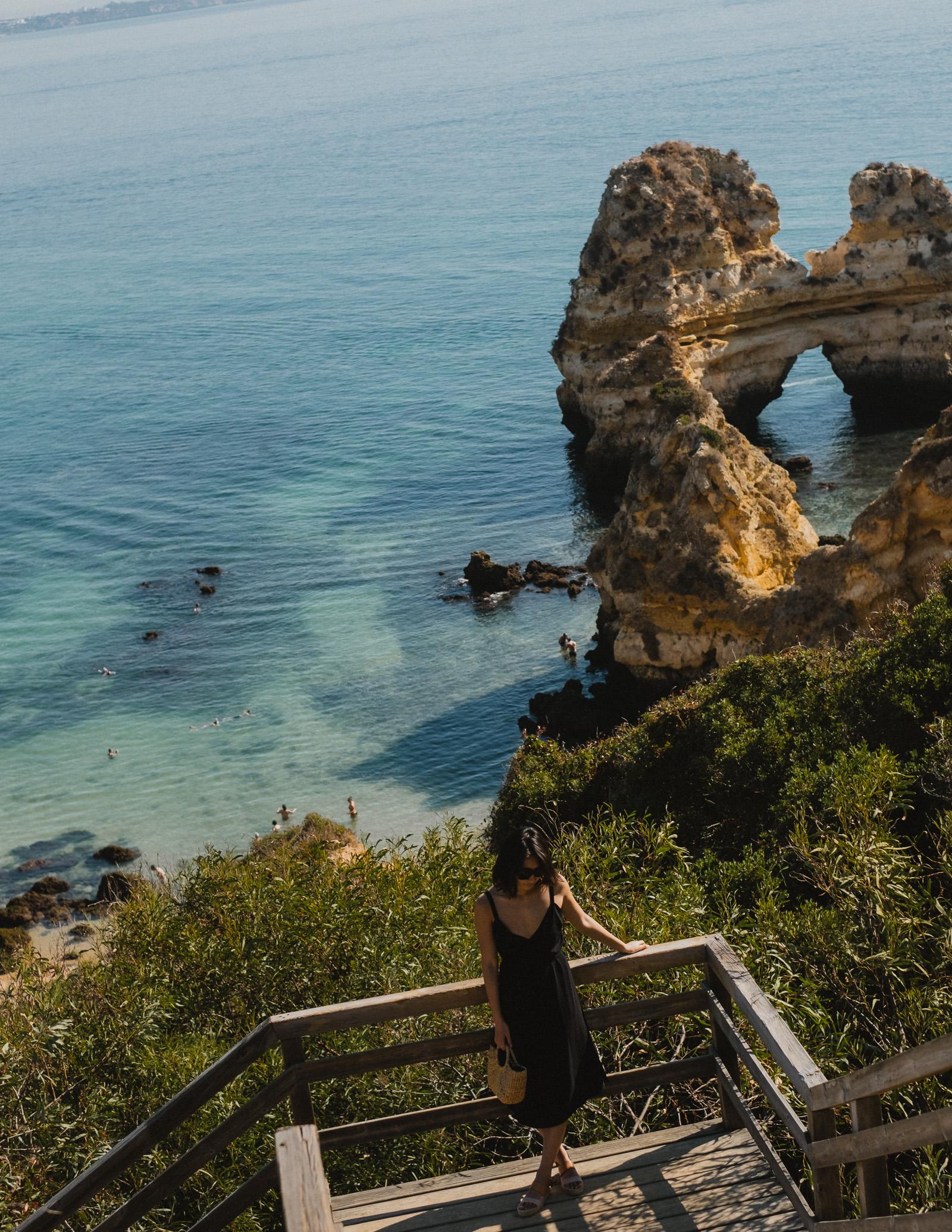 Climbing the 100 steps down to Praia do Camilo.