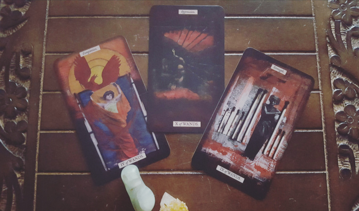 Four of Wands done right; 10 of Wands so heavy I dropped it on sight;  9 of Wands that has me conflicted- on one hand how nice to see a Black woman featured, on the other hand it would be wonderful if dark-skinned women in tarot art didn't feature so heavily in cards that evoke strength, perseverance or endurance. We'd like to be soft and vulnerable too. Find us some Cups cards to be featured in- draw me like one of your French girls!