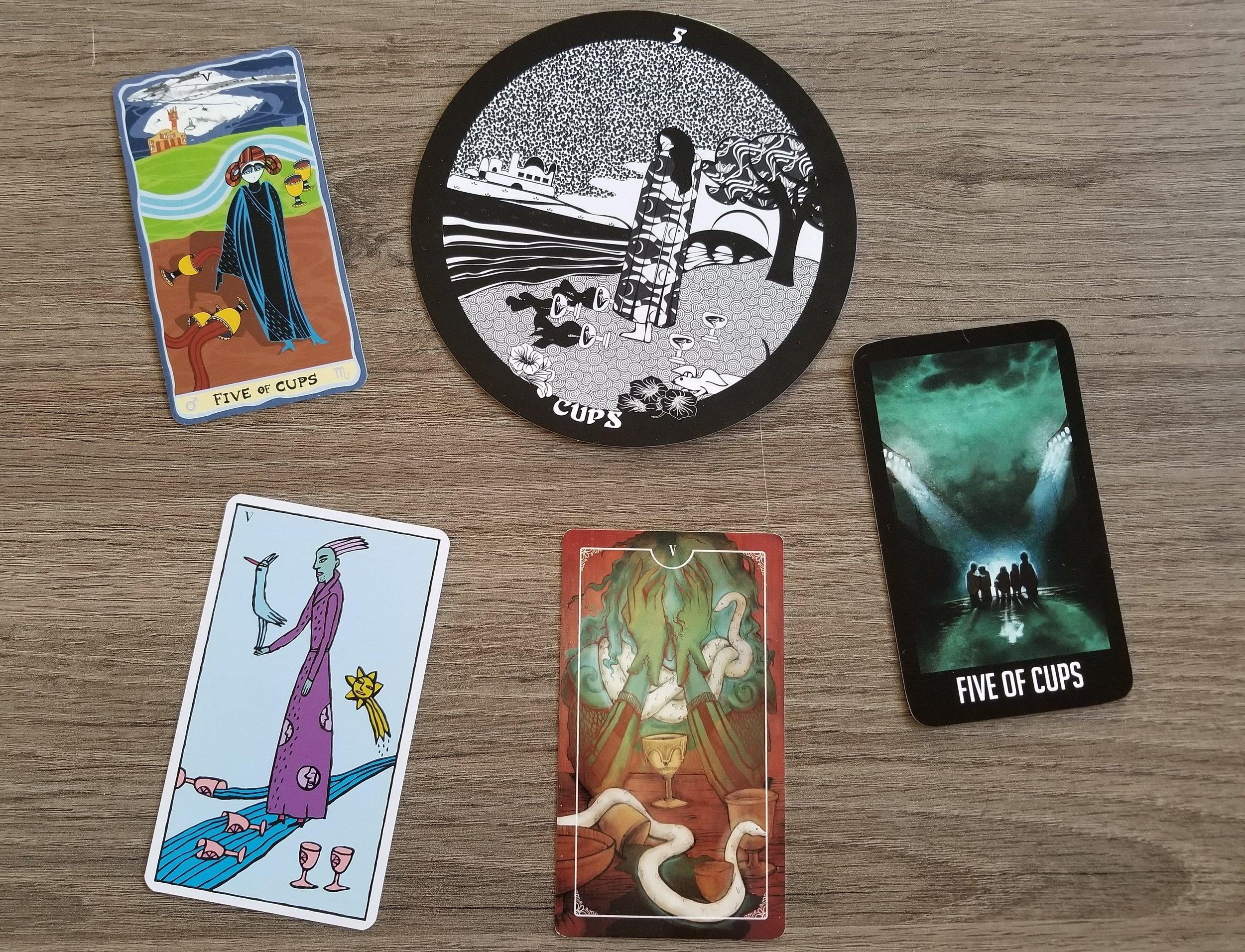 Five of Cups from the Sakki Sakki Tarot, Gorgon's Tarot, Kitty Kahane Tarot, Ostara Tarot, and the Welcome to Night Vale Tarot