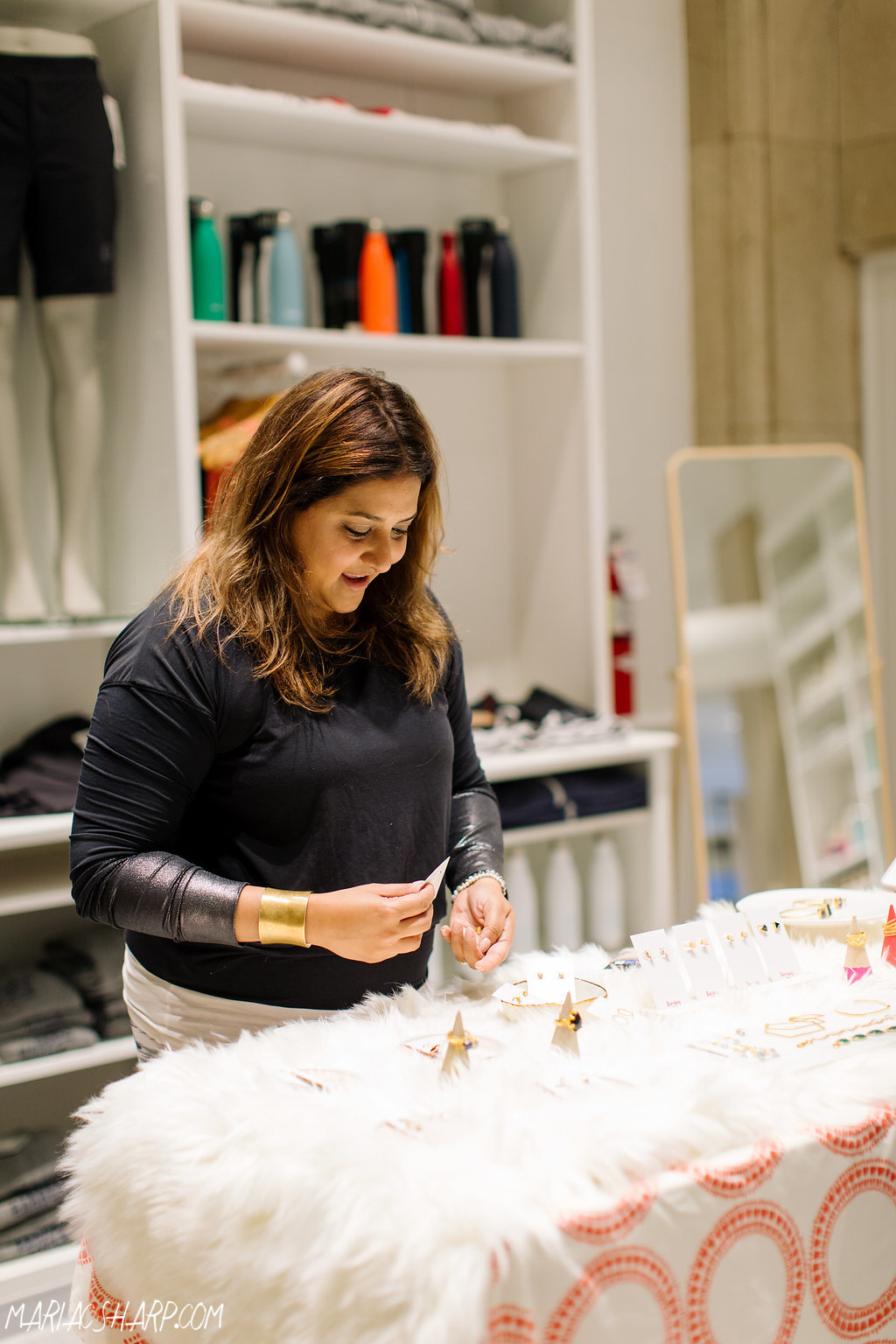 Shibani, the owner of Bombay Taxi Boutique selling jewelry at the Harness Event. Photo by Maria Sharp Photography.