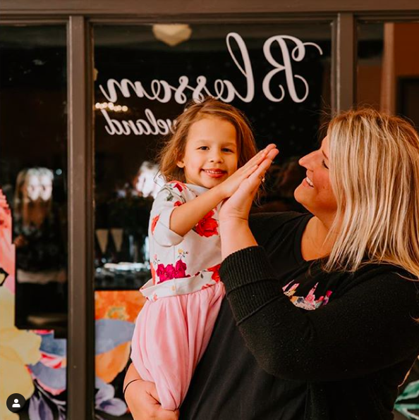 Megan Robinson with her daughter, Blossom, who inspired her store!