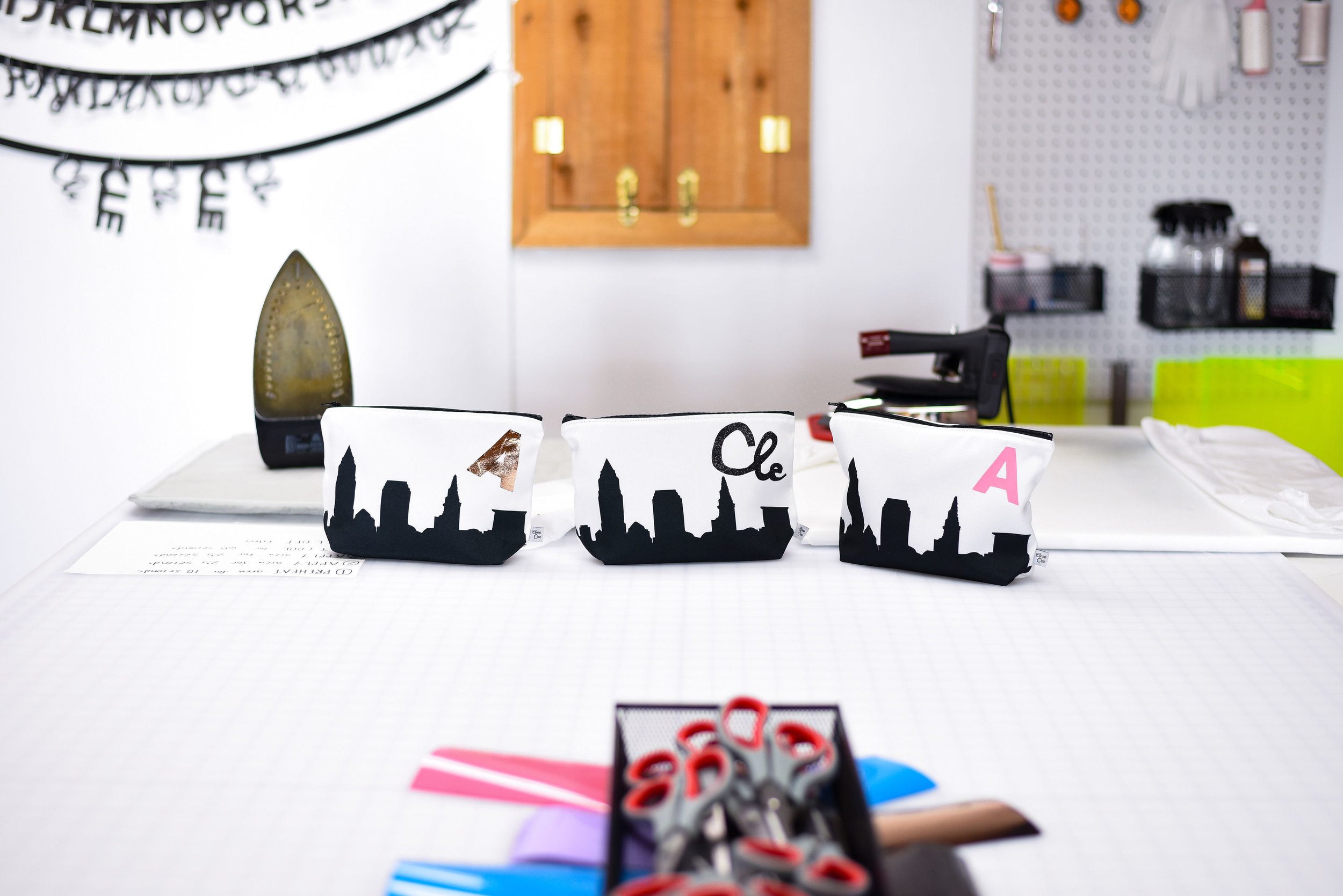 DIY makeup bag samples. Guests chose their city skyline from one of  Anne Cate's 85 city options , and monogrammed the bag themselves.  Photo by    Stephanie Penick Photography.