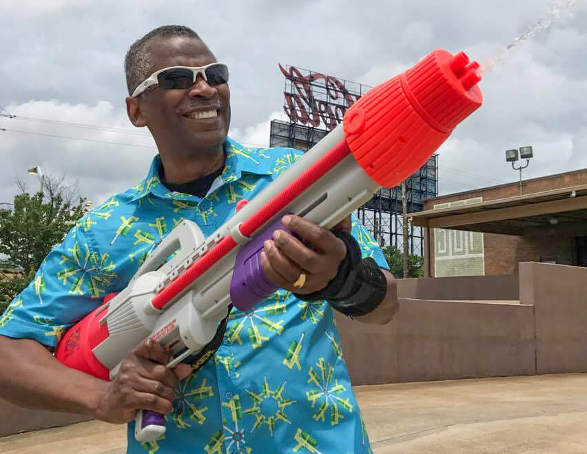 Source: USPTO, Lonnie Johnson plays around with a Super Soaker® while wearing a shirt patterned with images of his famous creation
