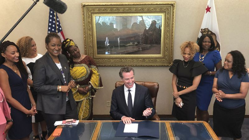 Source picture L.A.Times Gov. Gavin Newsom and Calafia's finest:  https://www.latimes.com/local/lanow/la-pol-ca-natural-hair-discrimination-bill-20190703-story.html